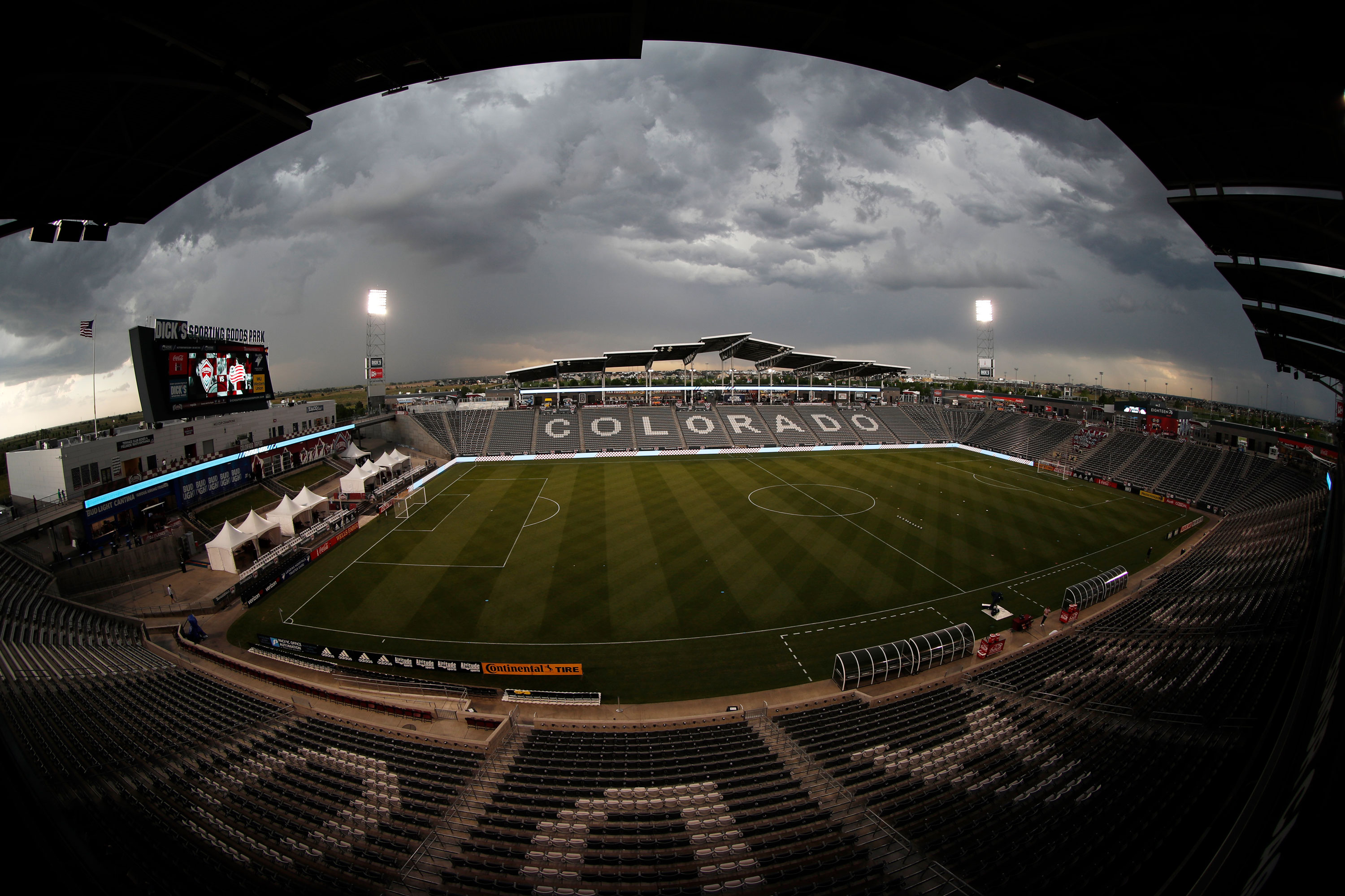 As viewed through a fisheye lens, storm clouds build over the stadium before an MLS soccer match between the New England Revolution and the Colorado Rapids on Thursday, July 4, 2019, in Commerce City, Colo.