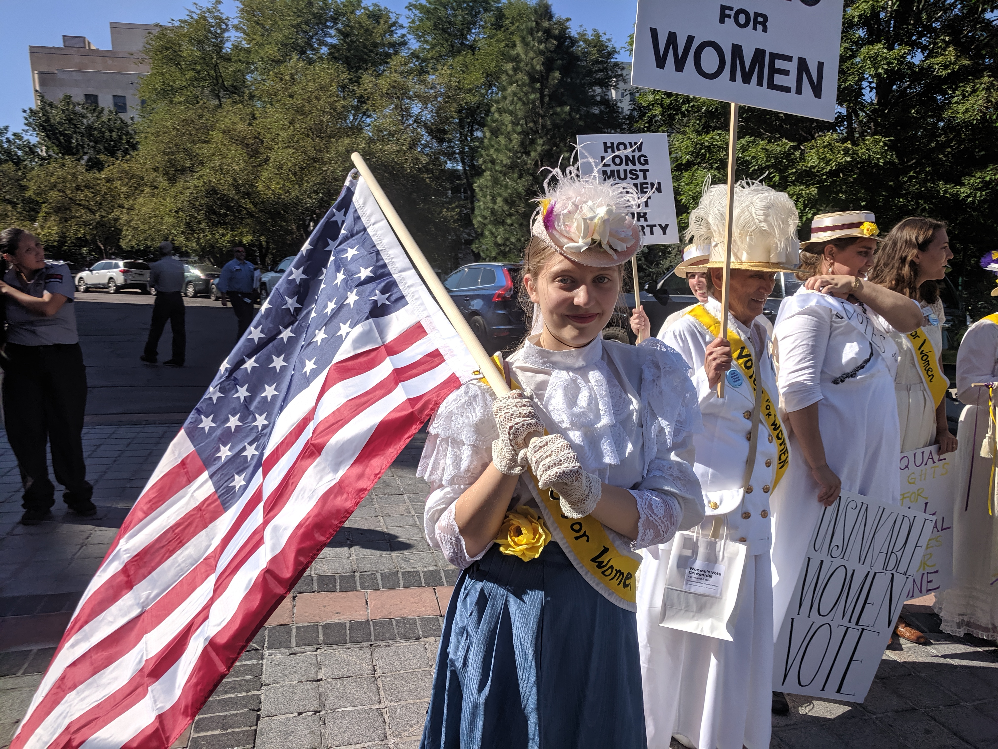 16-year-old Emma Davis dressed like an original Suffragist to celebrate the 99th anniversary of the ratification of the 19th Amendment on August 26, 2019.