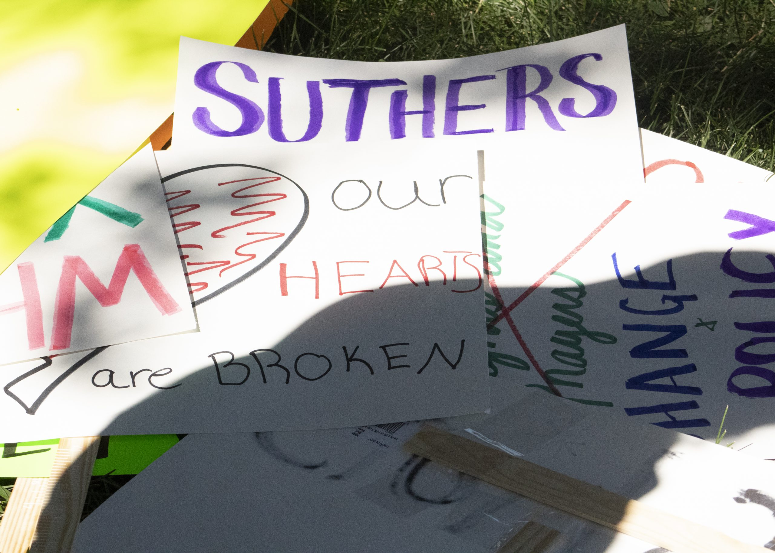 Signs at the press conference showed solidarity with the Bailey family and called out a lack of confidence in Mayor John Suthers.