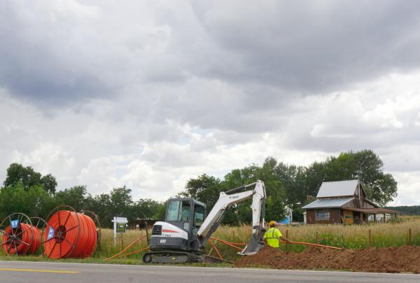 Construction crews work to install a new fiber line that will provide new high-speed internet service to the residents of Norwood.