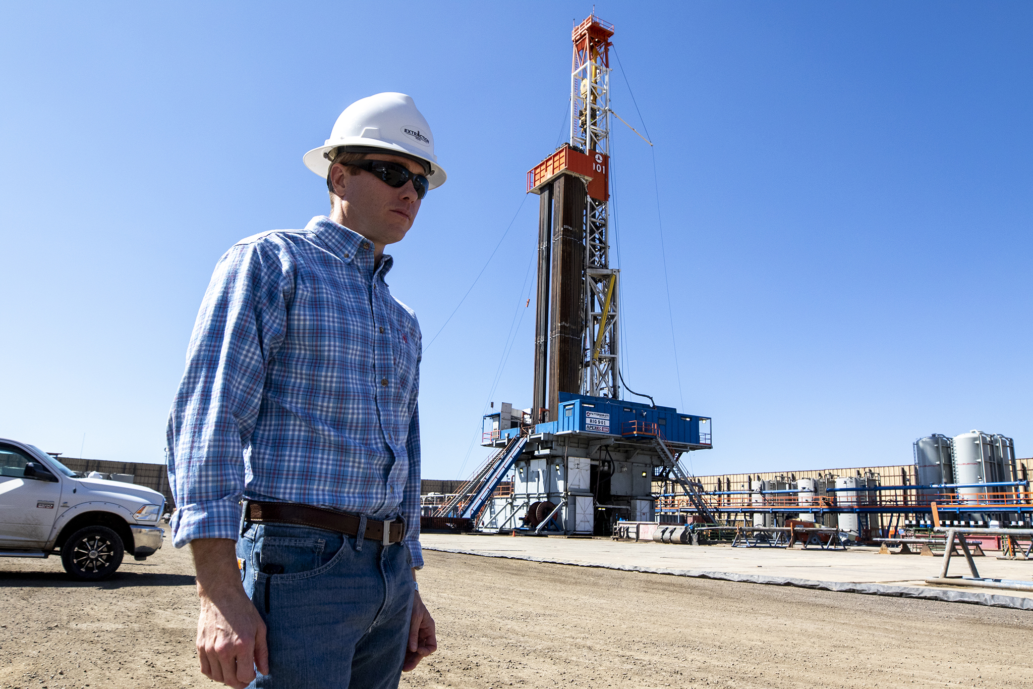 Extraction Oil and Gas' Brian Cain poses for a portrait on a drilling and fracking site, Sept. 13, 2019.