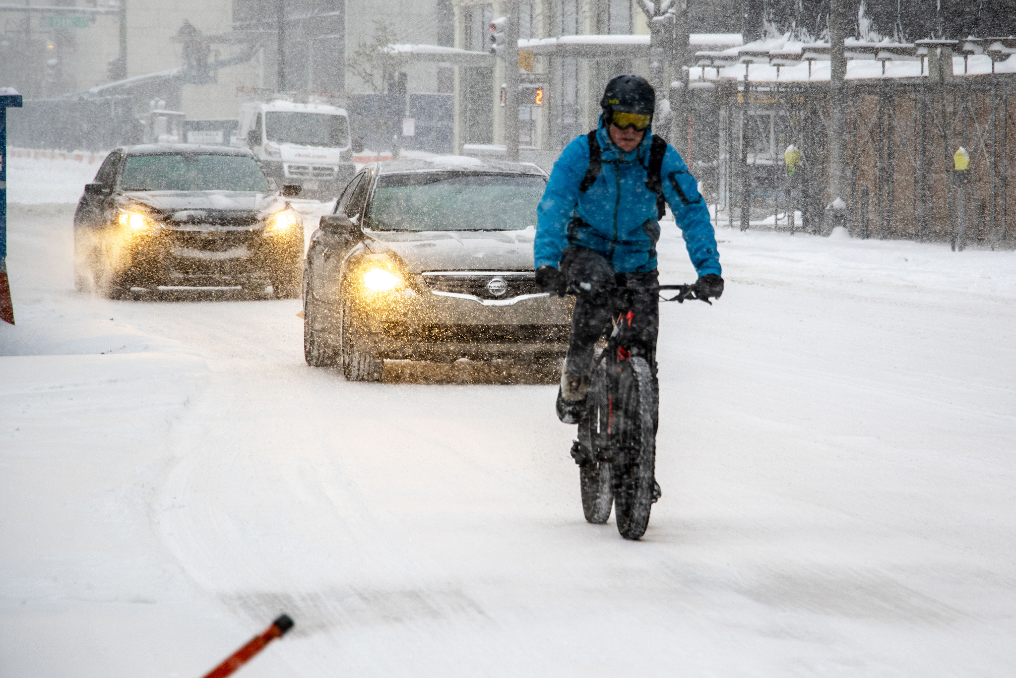 A brave man rides his bike downtown on a snowy day in Denver. Oct. 29, 2019.