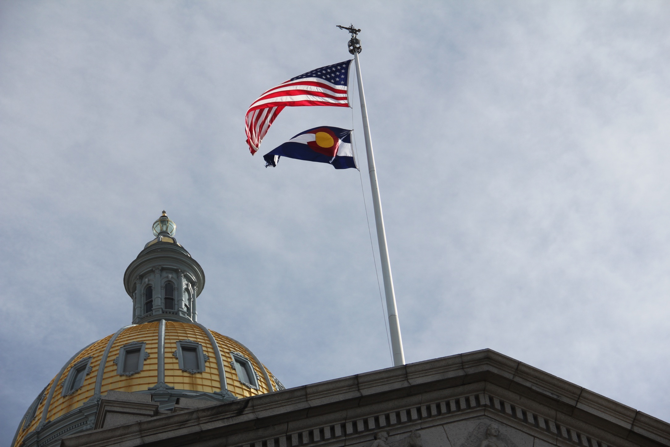 The U.S. flag and Colorado state flag at the Colorado State Capitol on Monday, Feb. 4, in Denver.