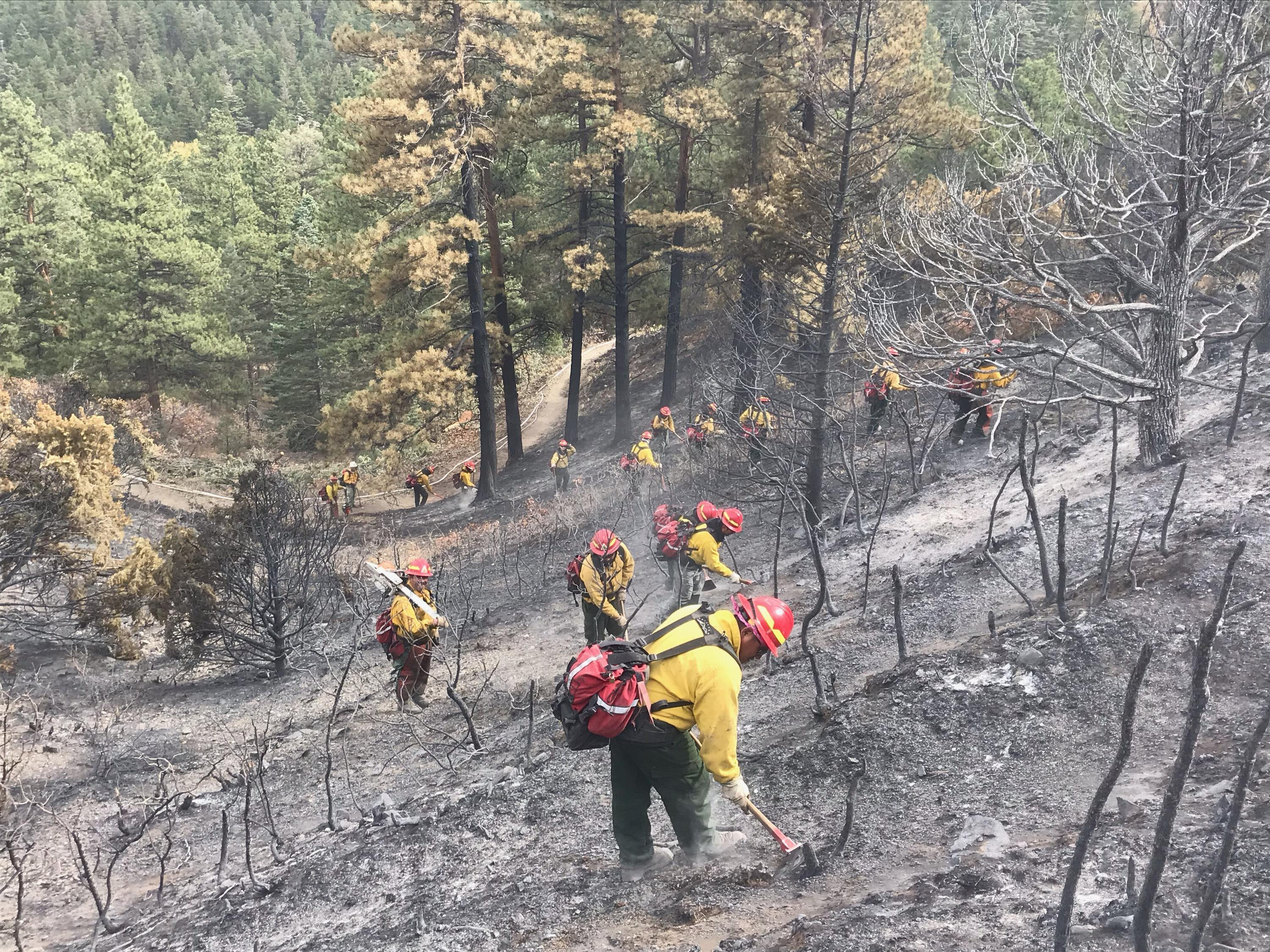 Firefighters on the Decker Fire conducting mop-up operations in Bear Creek, Oct. 17, 2019