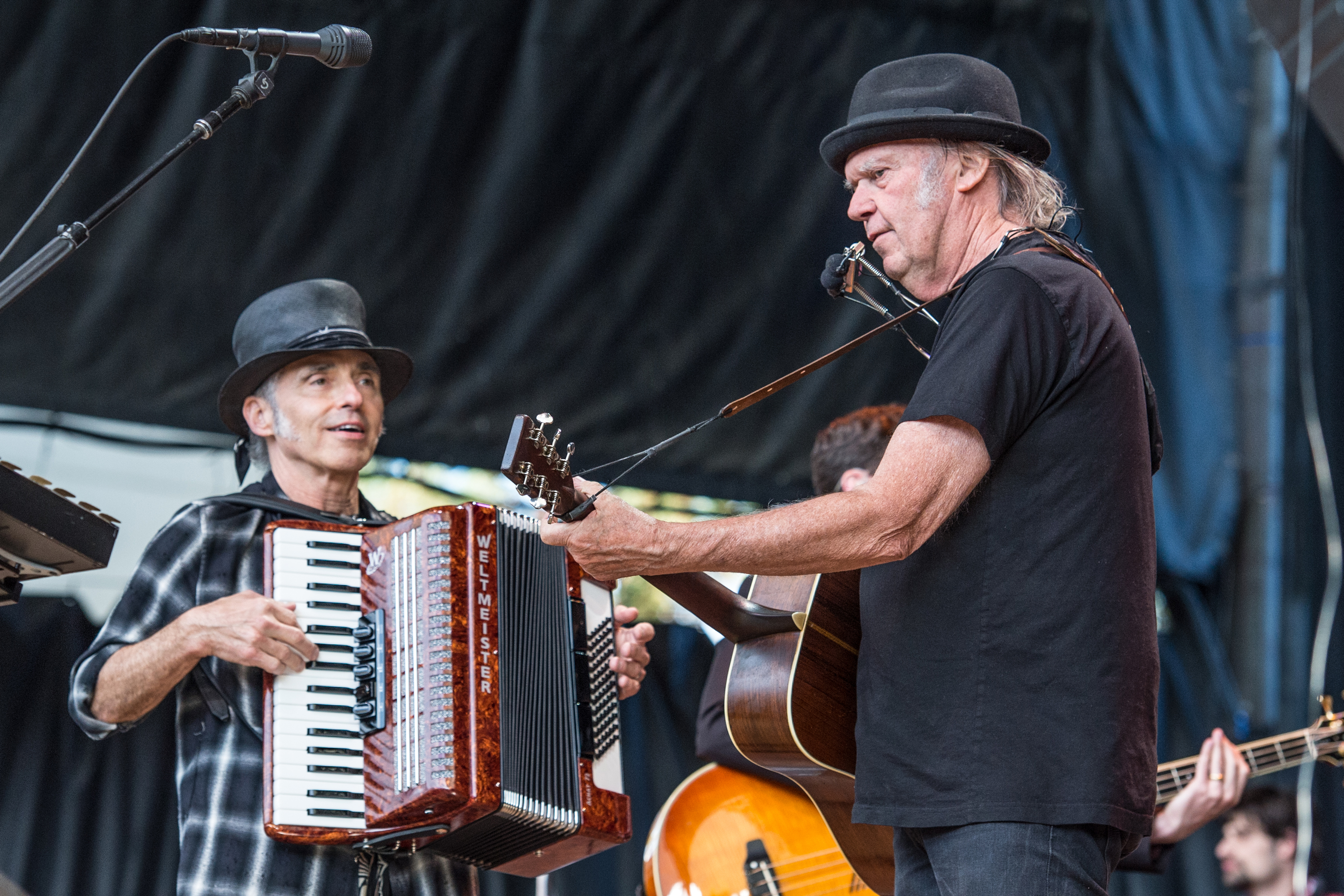 Nils Lofgren, left, and Neil Young perform at the 30th Annual Bridge School Benefit Concert at the Shoreline Amphitheater on Sunday, Oct. 23, 2016, in Mountain View, Calif.