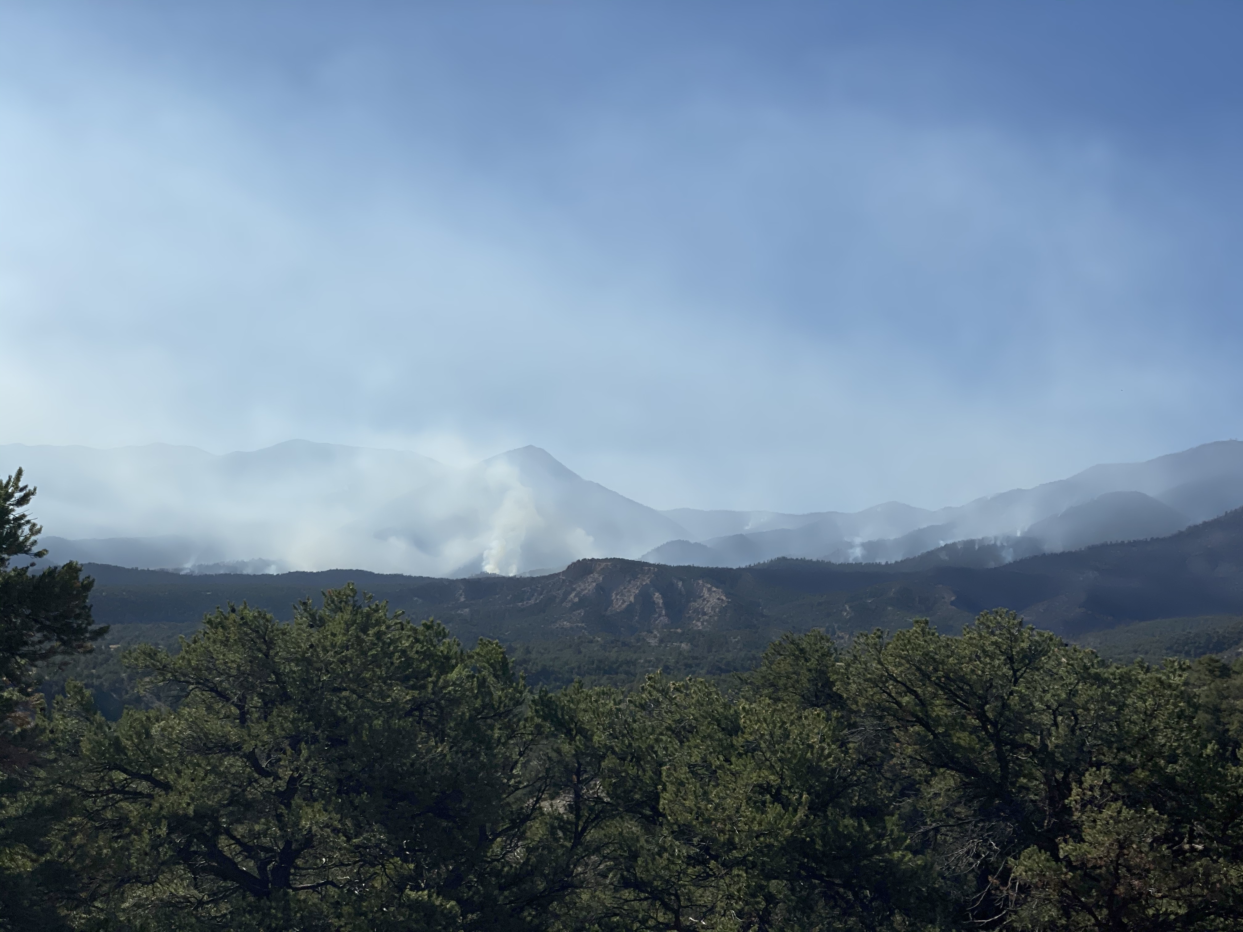 Smoke climbs up from a ridgeline along the Decker Fire, October 16, 2019.