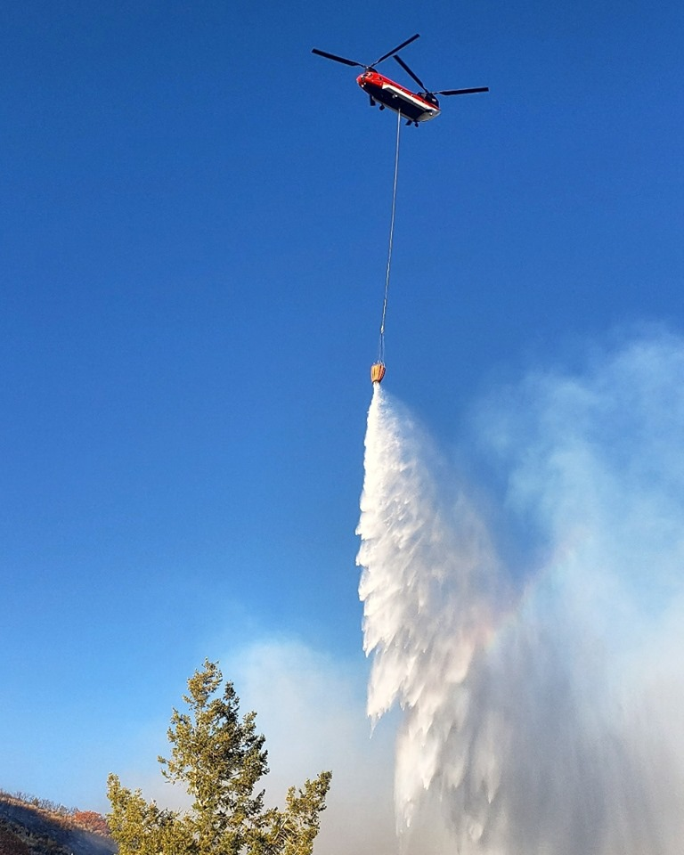 A Type 1 Chinook helicopter drops water Sunday, Oct. 6.