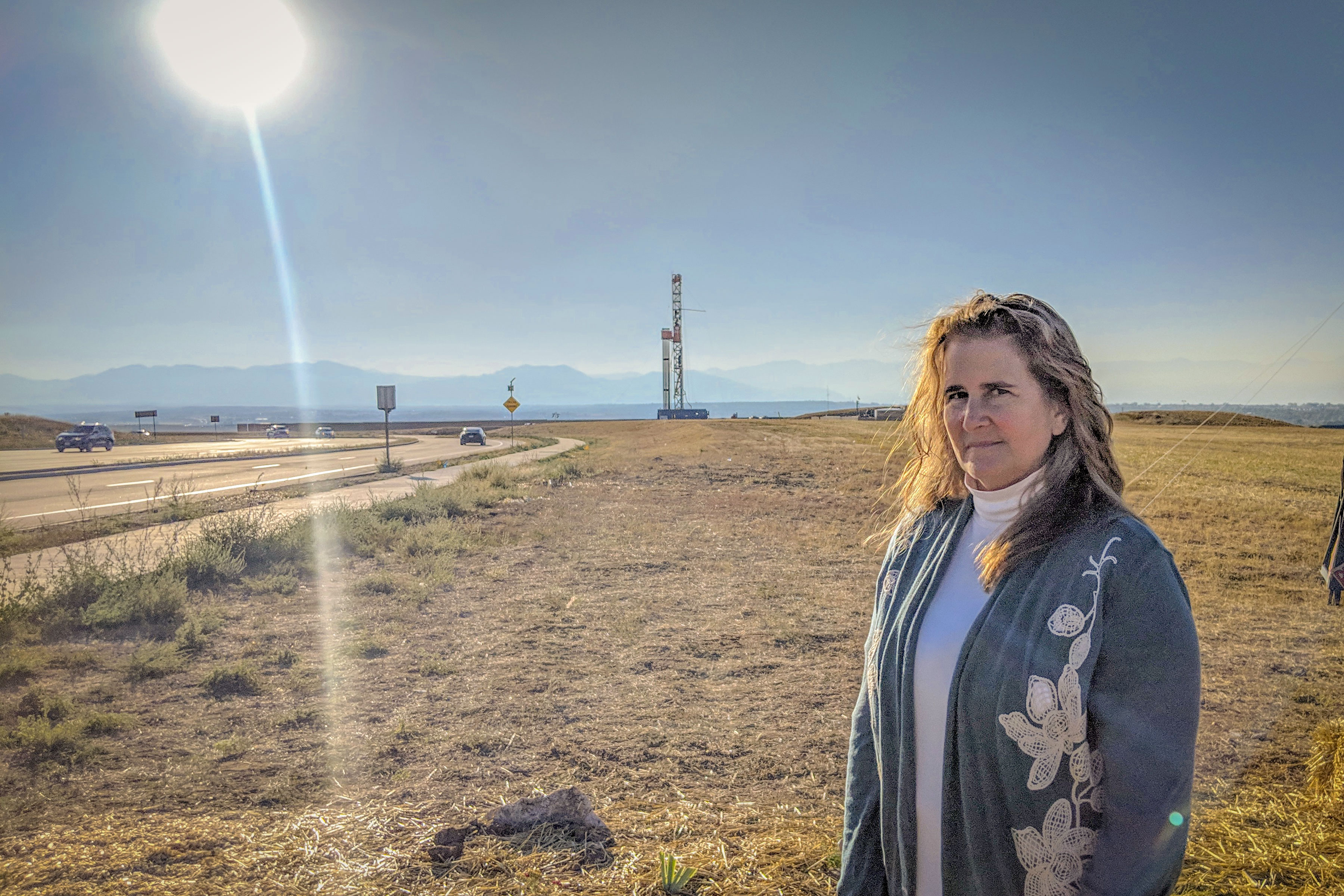 Democratic U.S. Sen. Candidate Diana Bray stands in front of a controversial drilling project n Broomfield, Colo.