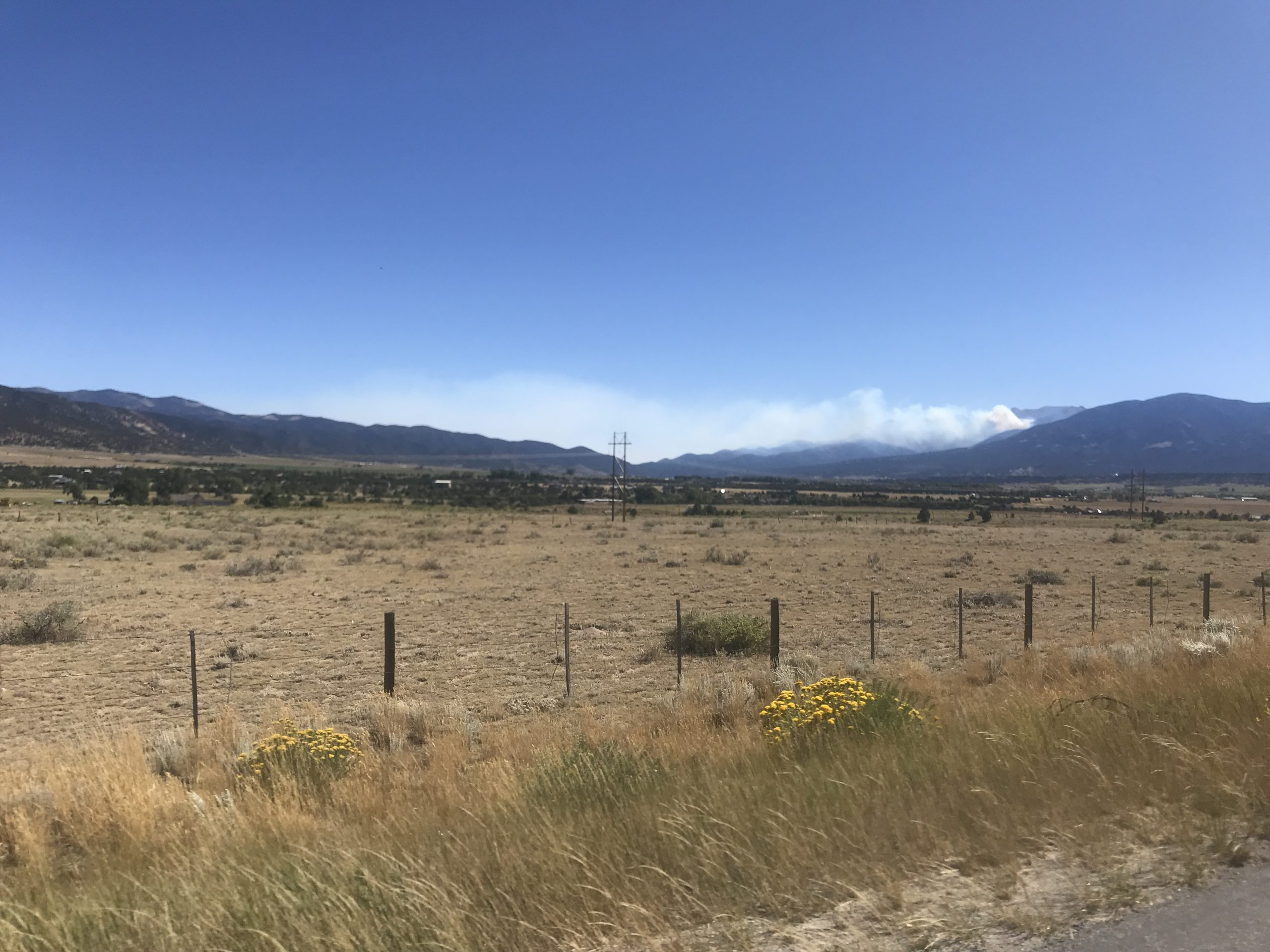 Smoke from the Decker Fire, visible from U.S. 285 on Sunday, September 22, 2019.