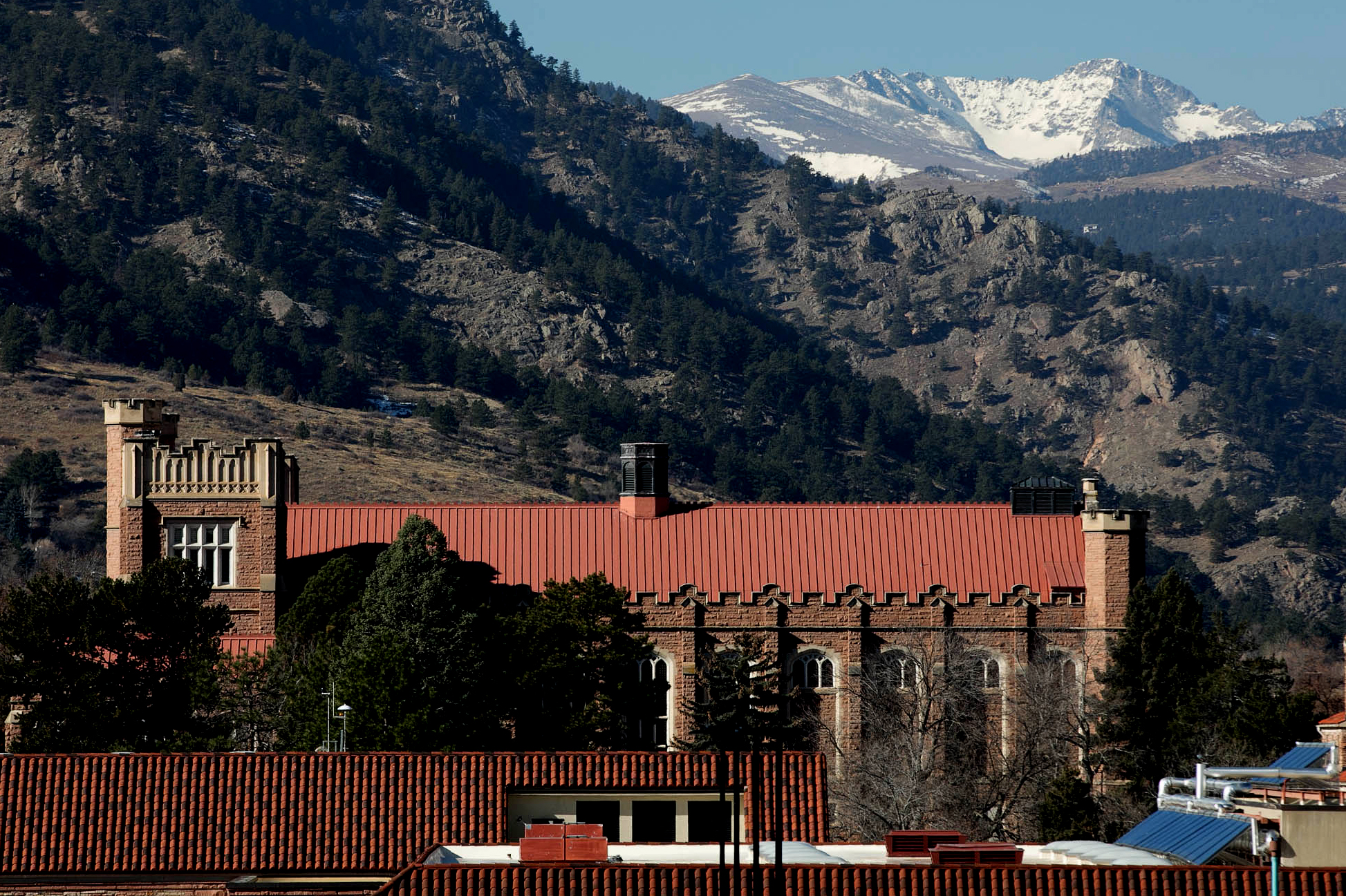 Mackey Auditorium's red tile roof on the CU Boulder campus