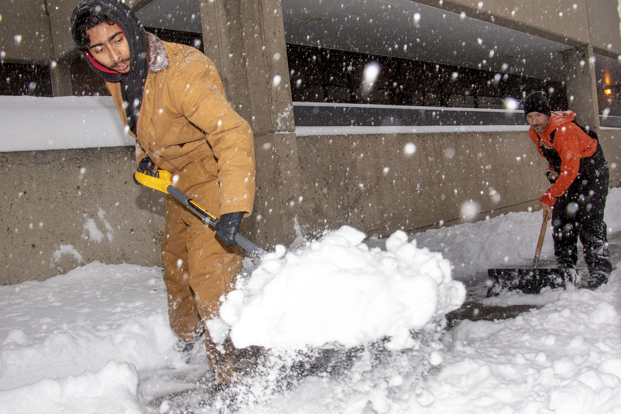 Jovony (left) and Hondo Padilla shovel snow on Lincoln Street, Nov. 26, 2019.