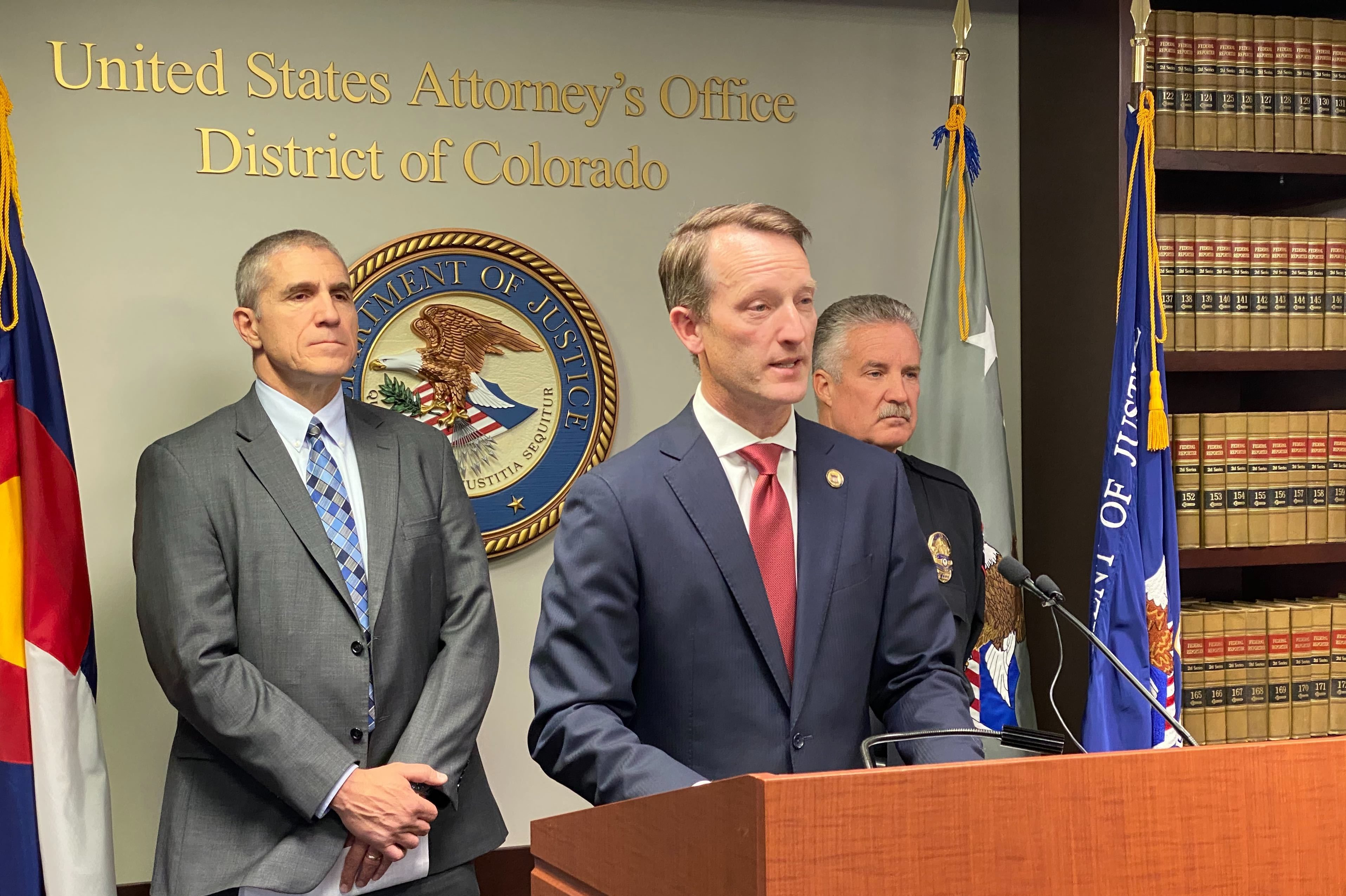 U.S. Attorney Jason R. Dunn, flanked by Special Agent in Charge Dean Phillips for the FBI Denver Division, left, and Pueblo Chief of Police Troy Davenport announce the arrest in a plot to bomb Temple Emanuel Synagogue in Pueblo, Colo., Nov. 4, 2019.