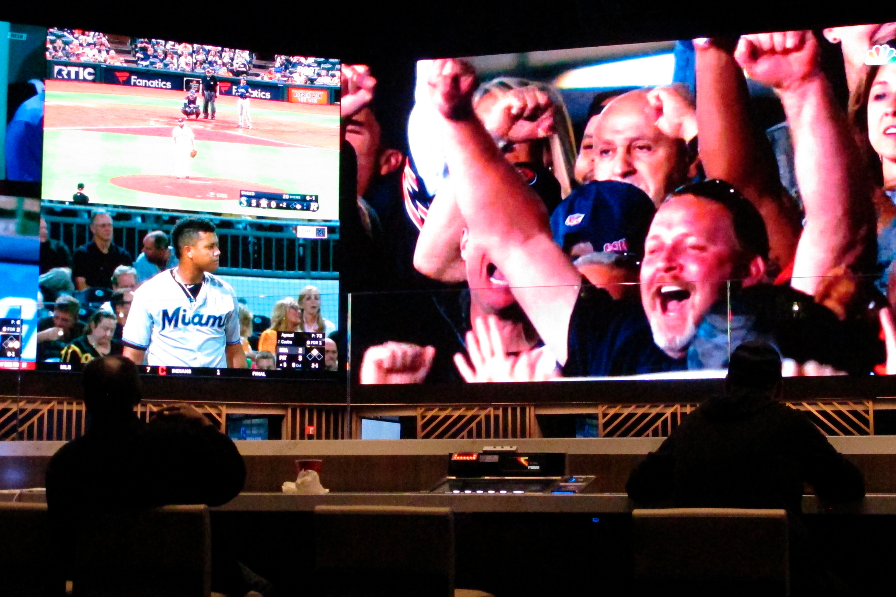 In this Sept. 5, 2019 photo, customers watch the first game of the new National Football League season in the sports betting lounge at Bally's casino in Atlantic City N.J.