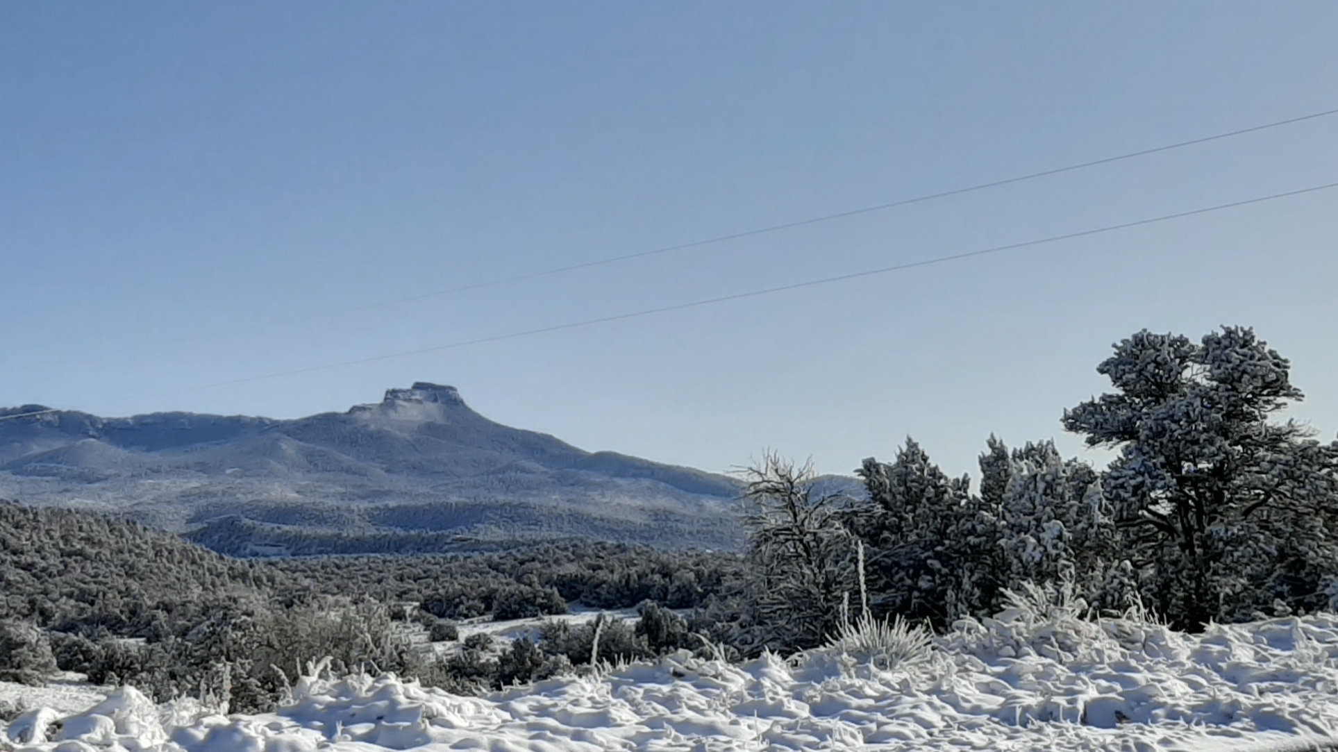 A snowy view of Fisher's Peak from the currently halted Cougar Canyon development.