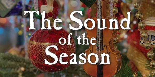 "Close up of Christmas tree ornaments with the words ""The Sound of the Season"""