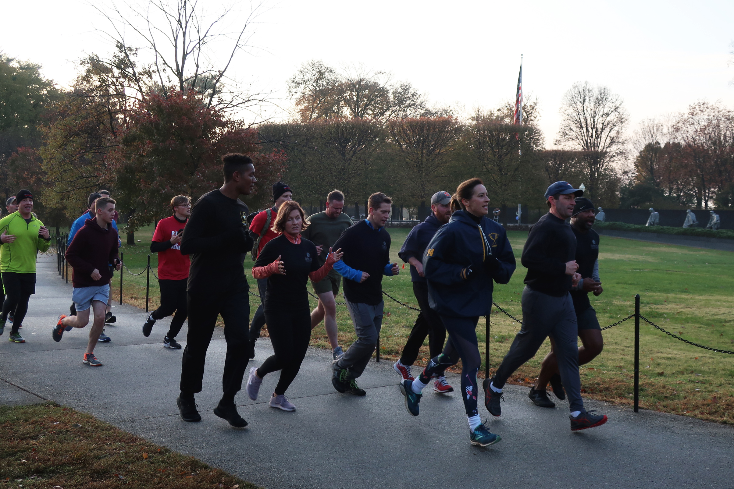 Rep. Jason Crow leads a group of Congressional veterans on a jog through possible Global War on Terrorism Memorial sites.