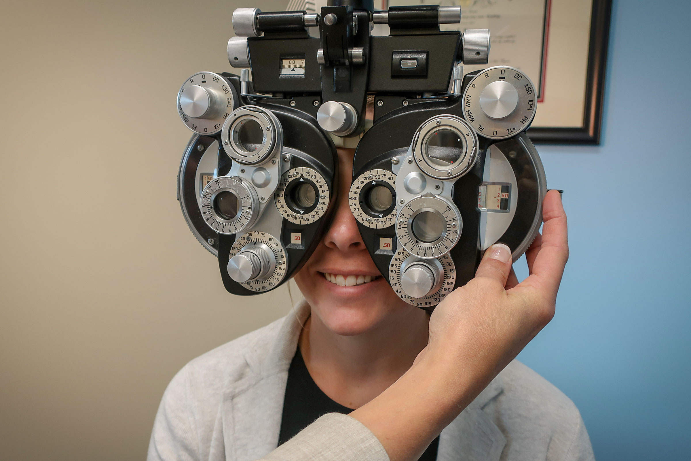 Kelsey Regan looks through the phoropter at the Mountain Vista Eyecare and Dry Eye Center in Littleton, CO. on Nov. 20, 2019.