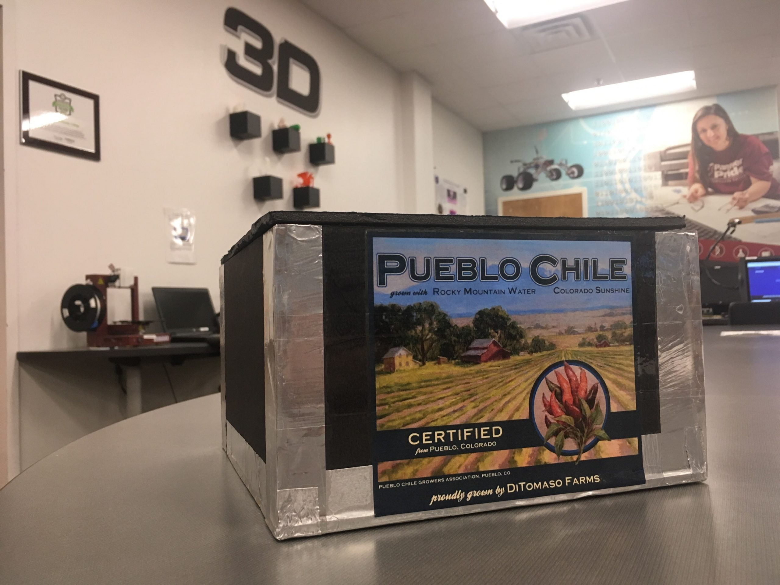 The box that will be sent to the stratosphere with the Pueblo Chili seeds.