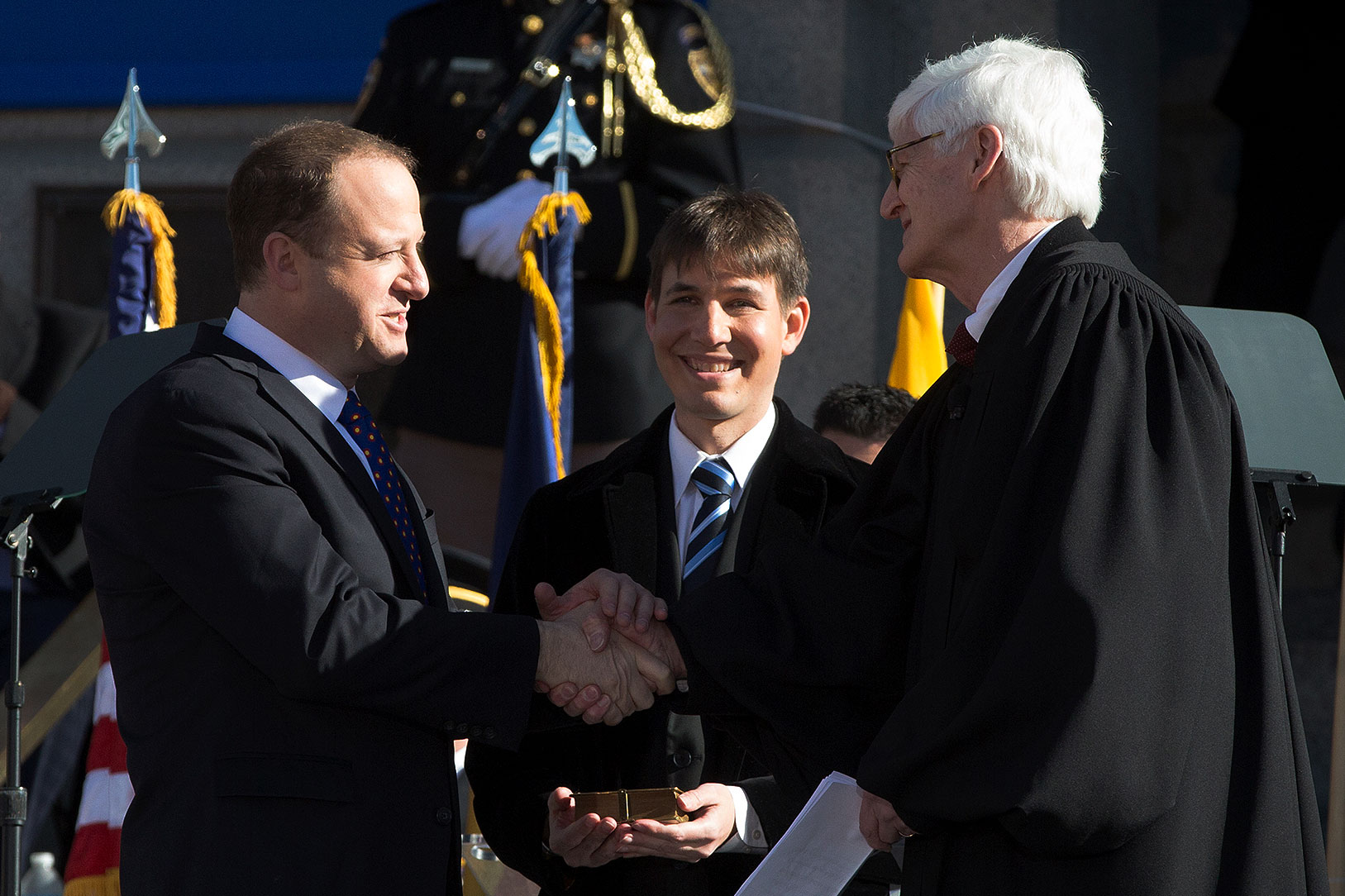 Jared Polis, accompanied by his husband Marlon Reis, takes the oath of office for governor administered by Colorado Supreme Court Chief Justice Nathan B. Coats on Jan. 8. Polis is the country's first openly gay man to be elected as any state's top executive.