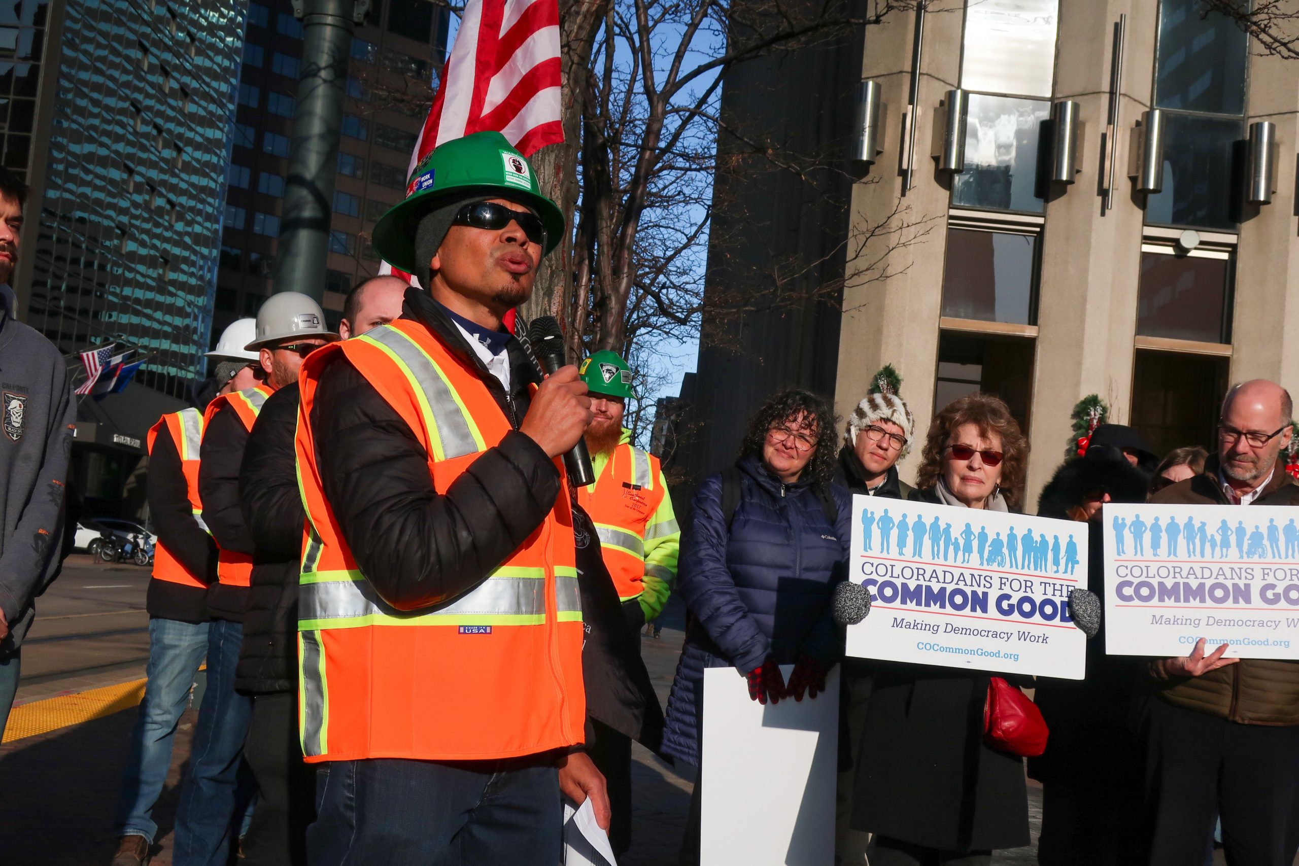 Carpenter and union representative Juan Arellano speaks in front of the Colorado Department of Labor and Employment in Denver on Monday, Dec. 16, 2019. Arellano was speaking in support of new rules that include construction workers in labor protections.