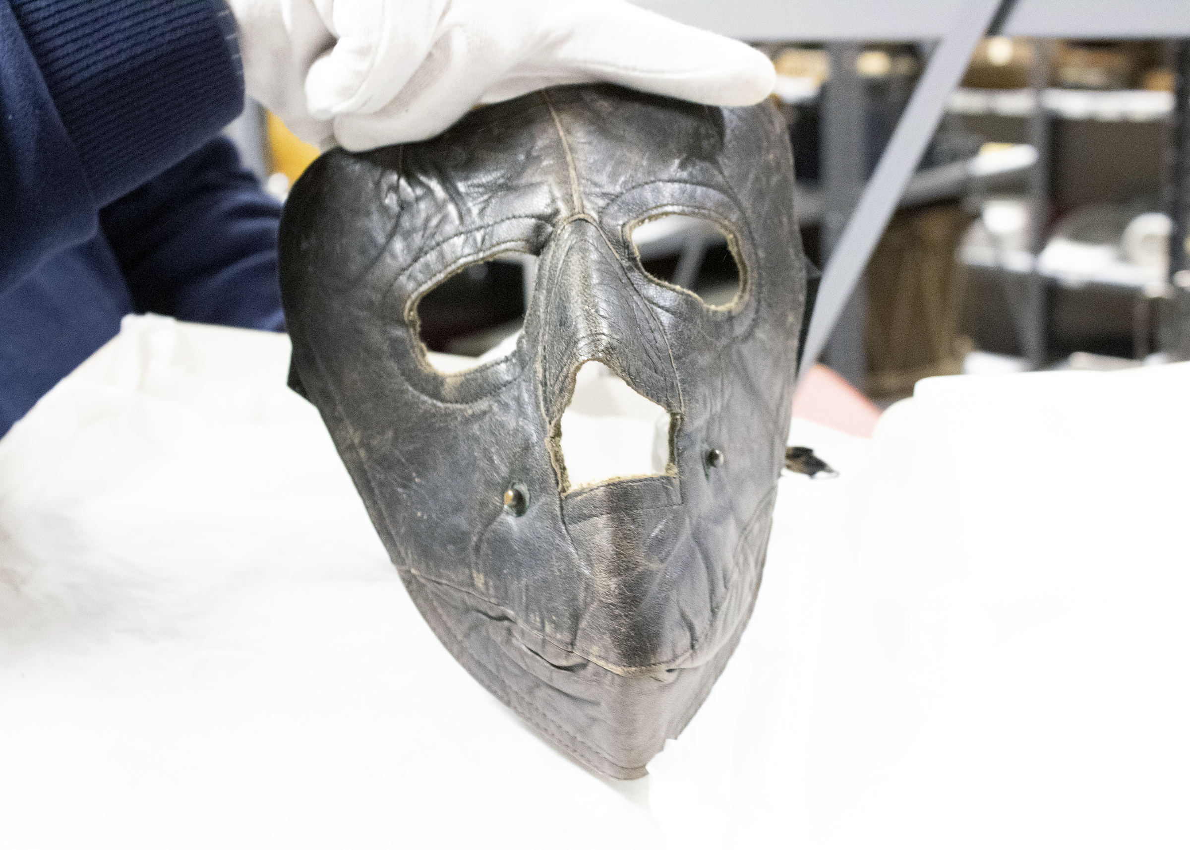 A close up photo of a mask worn by and early AdAmAn Club member to protect his face from the cold. This piece is part of a collection at the Colorado Springs Pioneers Museum.