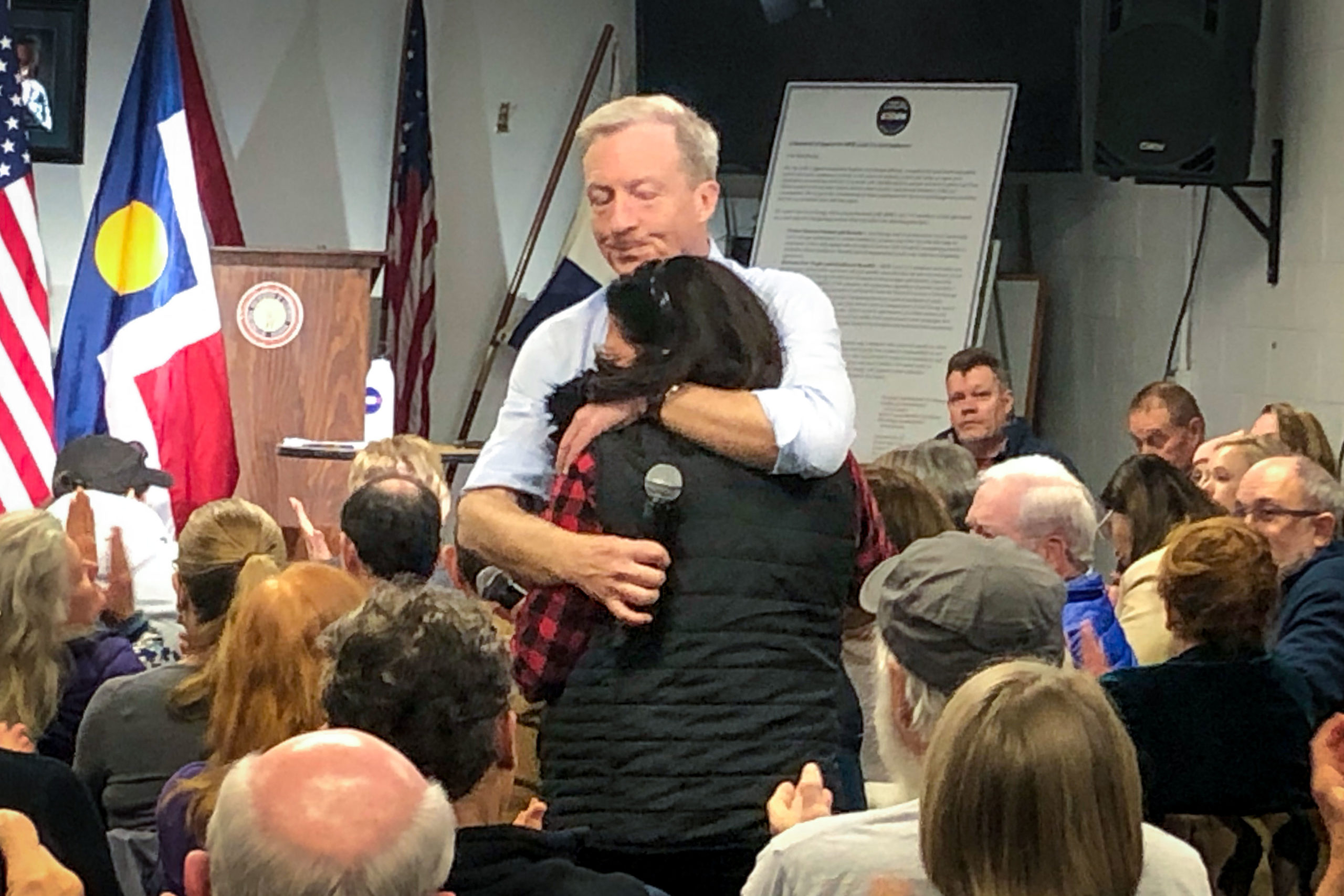 Democratic Presidential candidate Tom Steyer consoles Elizabeth Emerson of Castle Rock at a Denver town hall on Sunday, Dec. 29. Emerson's son Jacob was killed in a 2018 shooting.