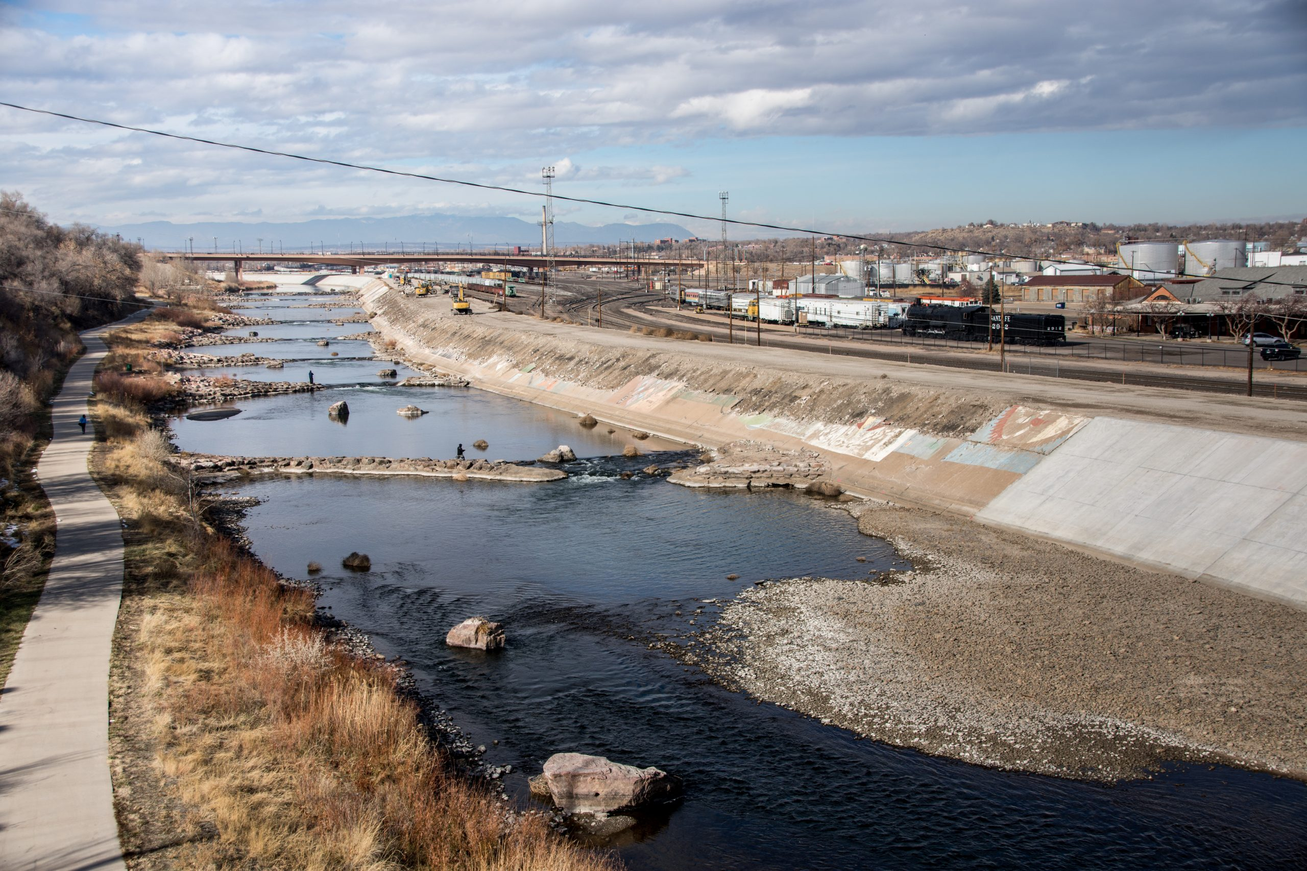 The last section of the Arkansas River levee in Pueblo will be resurfaced this winter. Here, the old surface containing the mural is being taken down, while the new surface is clean. Planning for new art is underway.