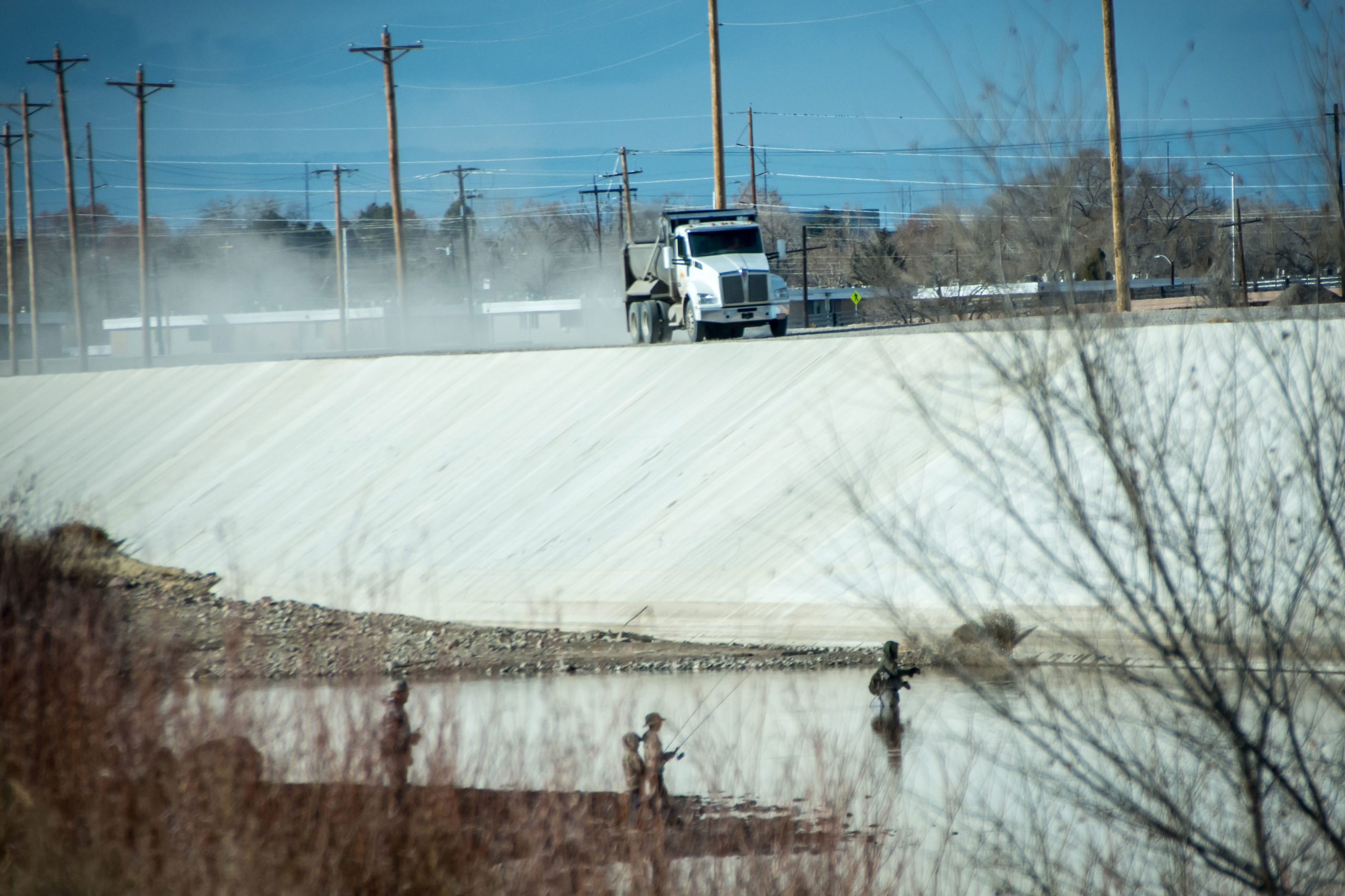 A work truck, part of the last phase of reconstruction, rumbles across the Arkansas River Levee in Pueblo, Colo., Nov. 29, 2019.