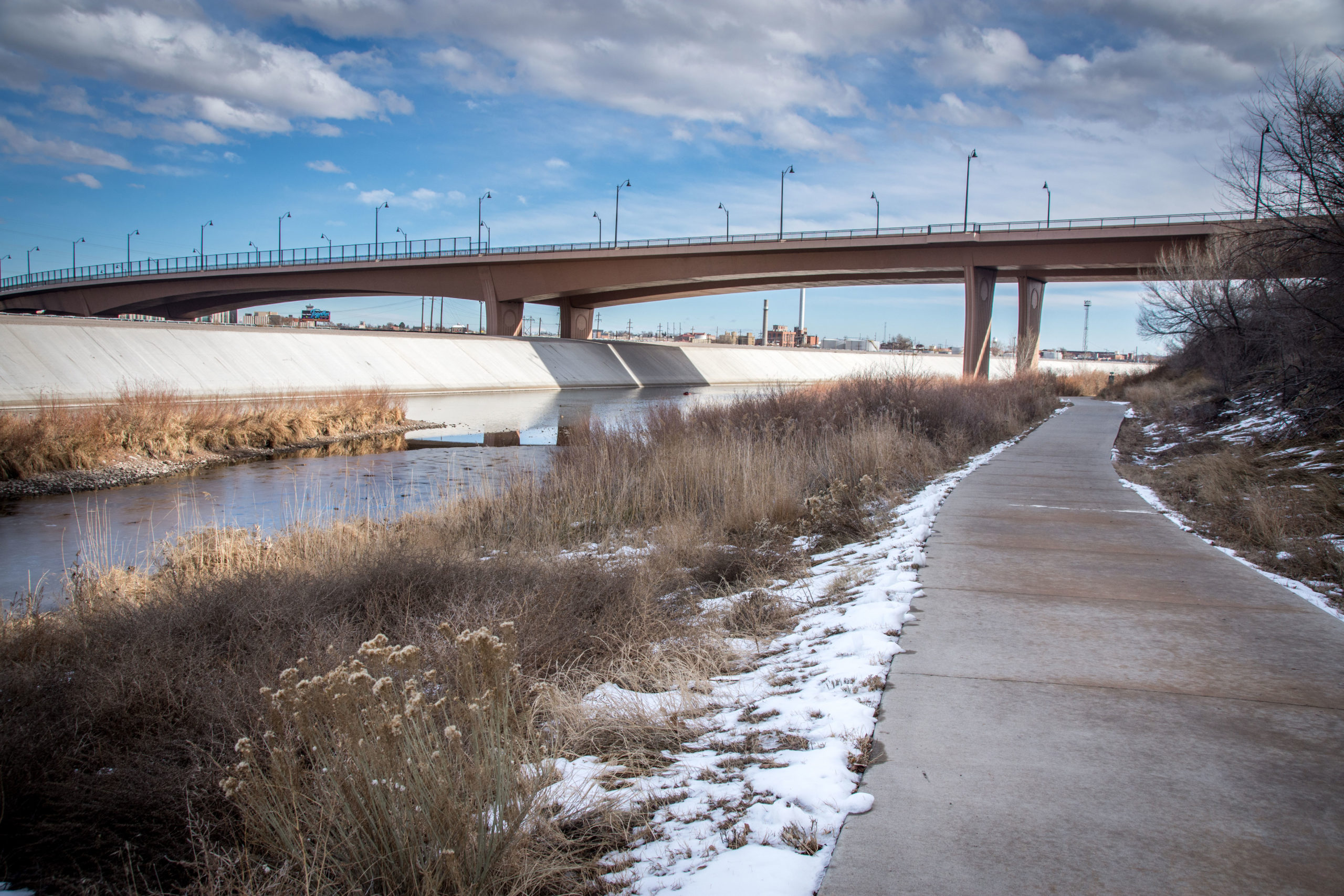 The hiking and biking path across from the Arkansas River Levee in Pueblo, Colo., Nov. 29, 2019. The levee was constructed to protect the city after 1921's devastating flood.