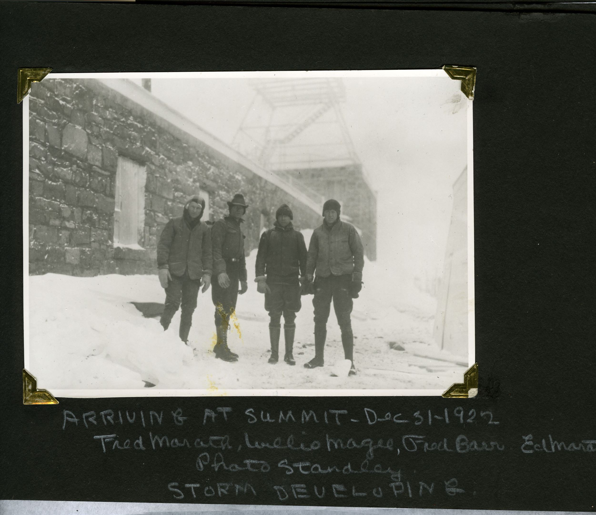 Taken December 31, 1922 four members of the Frozen Five stand near the shelter on the top of Pikes Peak. According to the AdAmAn website, at the stroke of midnight, they lit the flares and the other fireworks they had hauled up the mountain...