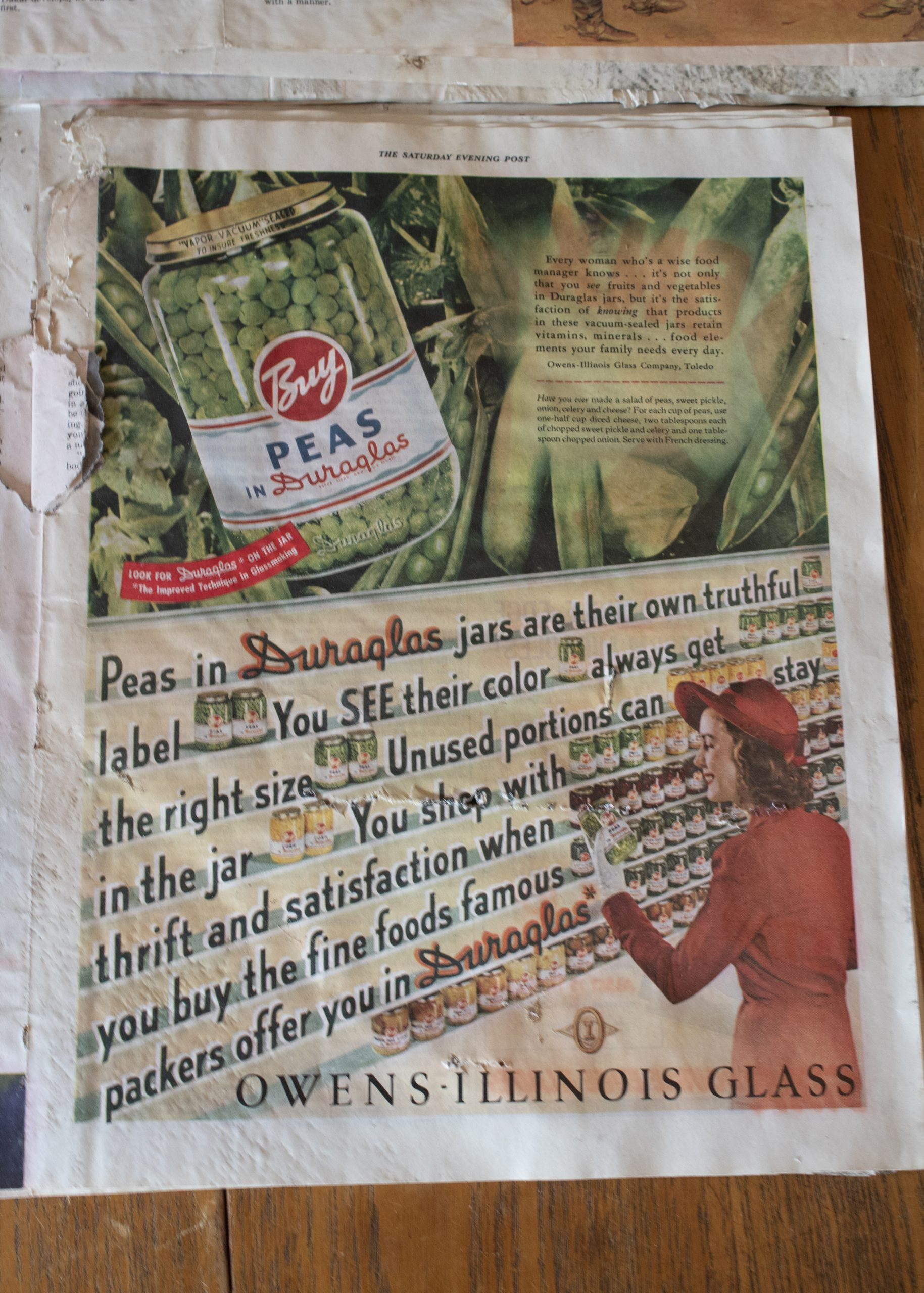An ad for peas, still bright with color, despite being under the floor of a Colorado Springs home for nearly seven decades.