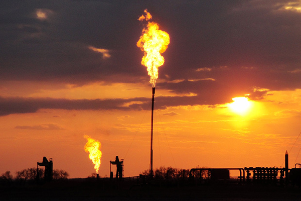 Flaring natural gas (largely methane) at a well site in North Dakota in 2014. The Bureau of Land Management relaxed rules regulating flared, leaked and vented methane from oil and gas operations on federal and tribal lands.