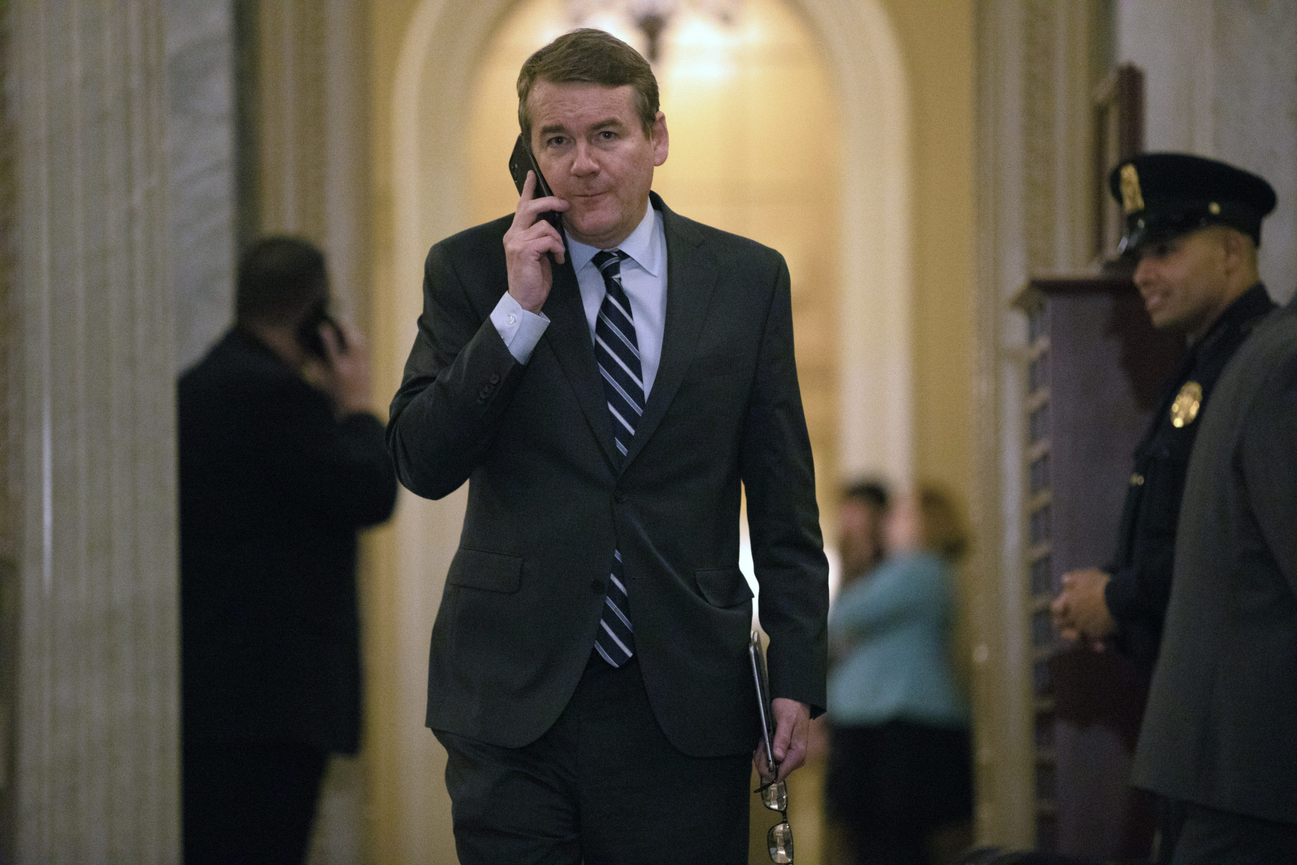 Sen. Michael Bennet, D-Colo., walks on Capitol Hill in Washington, Thursday, Jan. 30, 2020, as he returns to the Senate chamber after a break in the impeachment trial of President Donald Trump on charges of abuse of power and obstruction of Congress.