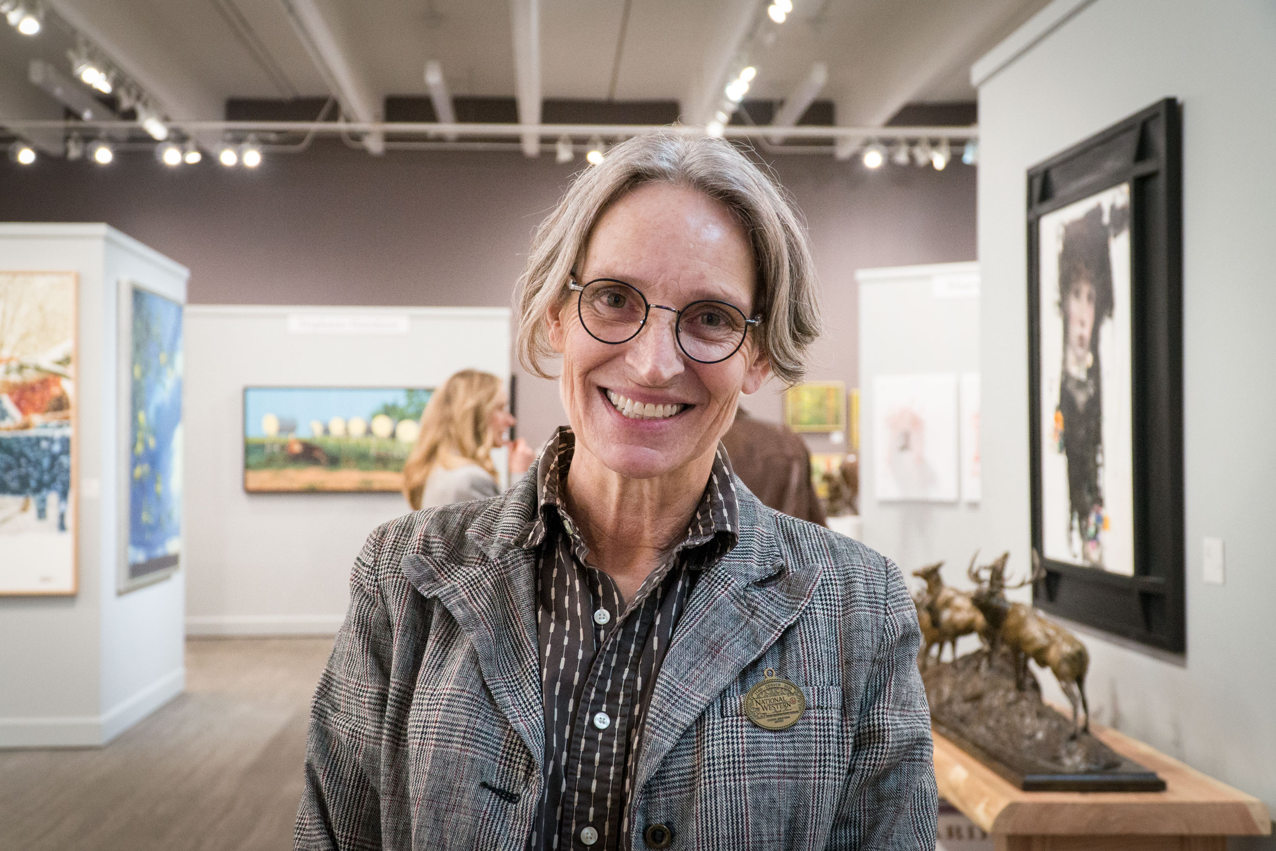Artist Sophy Brown, of Longmont, stands in the gallery of the Coors Western Art Exhibit at Denver's National Western Complex on Jan. 13, 2020.