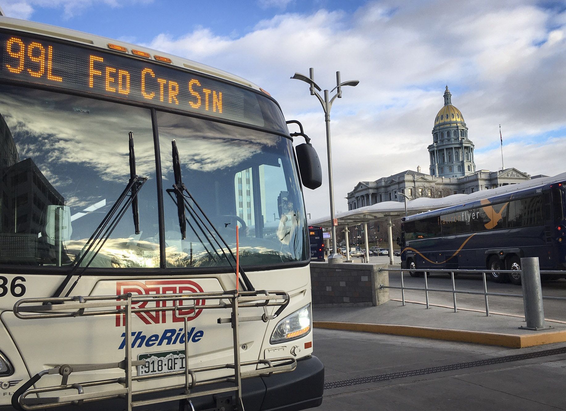 An RTD bus is parked at Civic Center Station in Denver, just across Colfax Avenue from the Colorado state Capitol.
