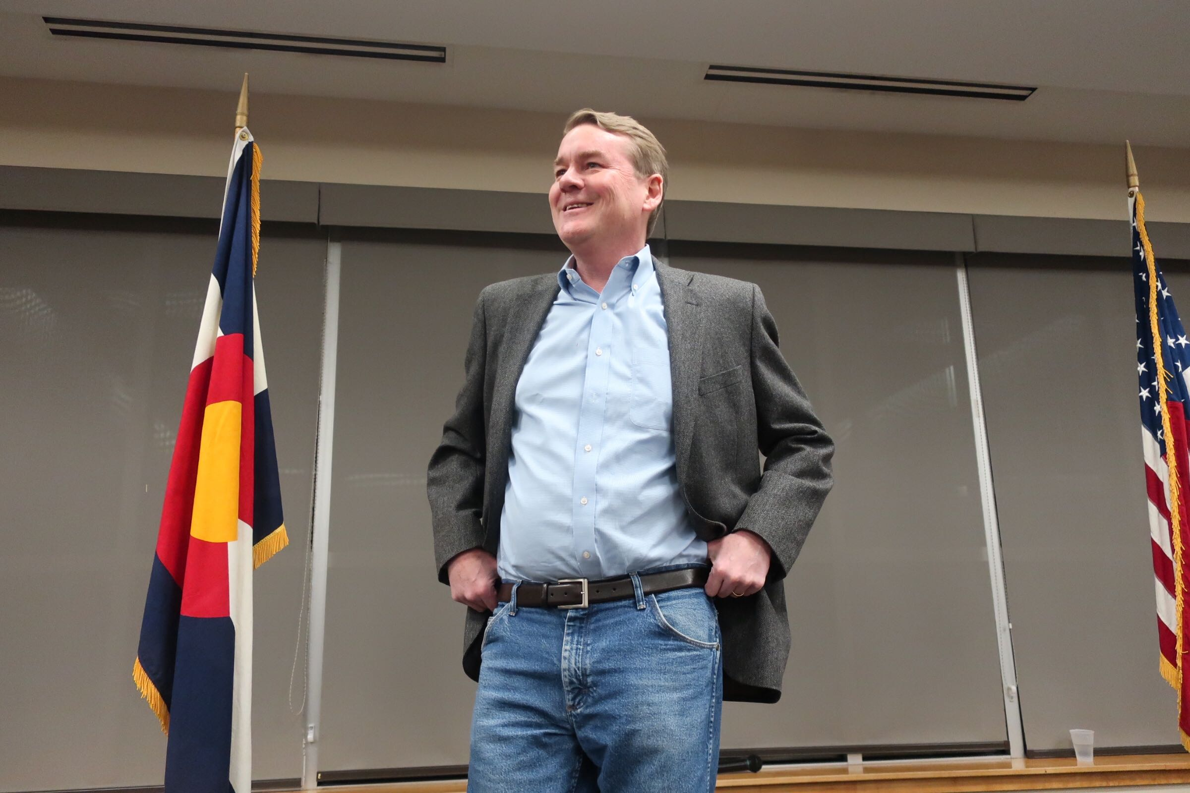 Sen. Michael Bennet, D-Colo., speaks at a town hall in Littleton on Feb. 18, 2020.