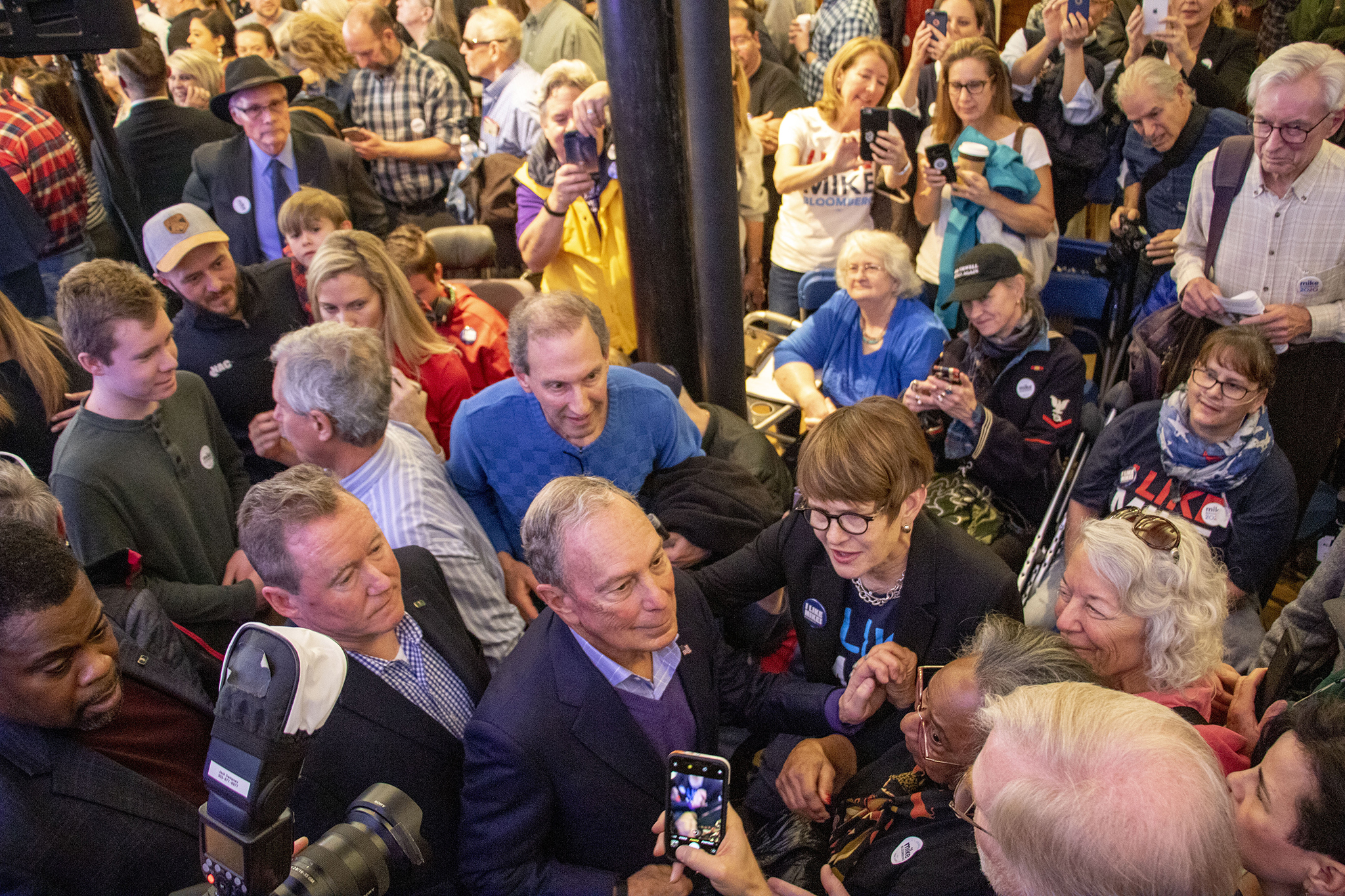 Mike Bloomberg greets supporters during the opening of his new campaign office in downtown Denver, Feb. 1, 2020.