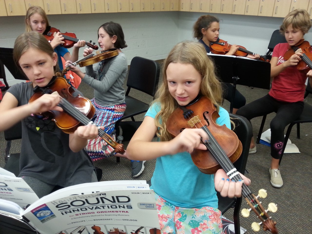 East Middle School students with instruments donated by the Bringing Music To Life drive.