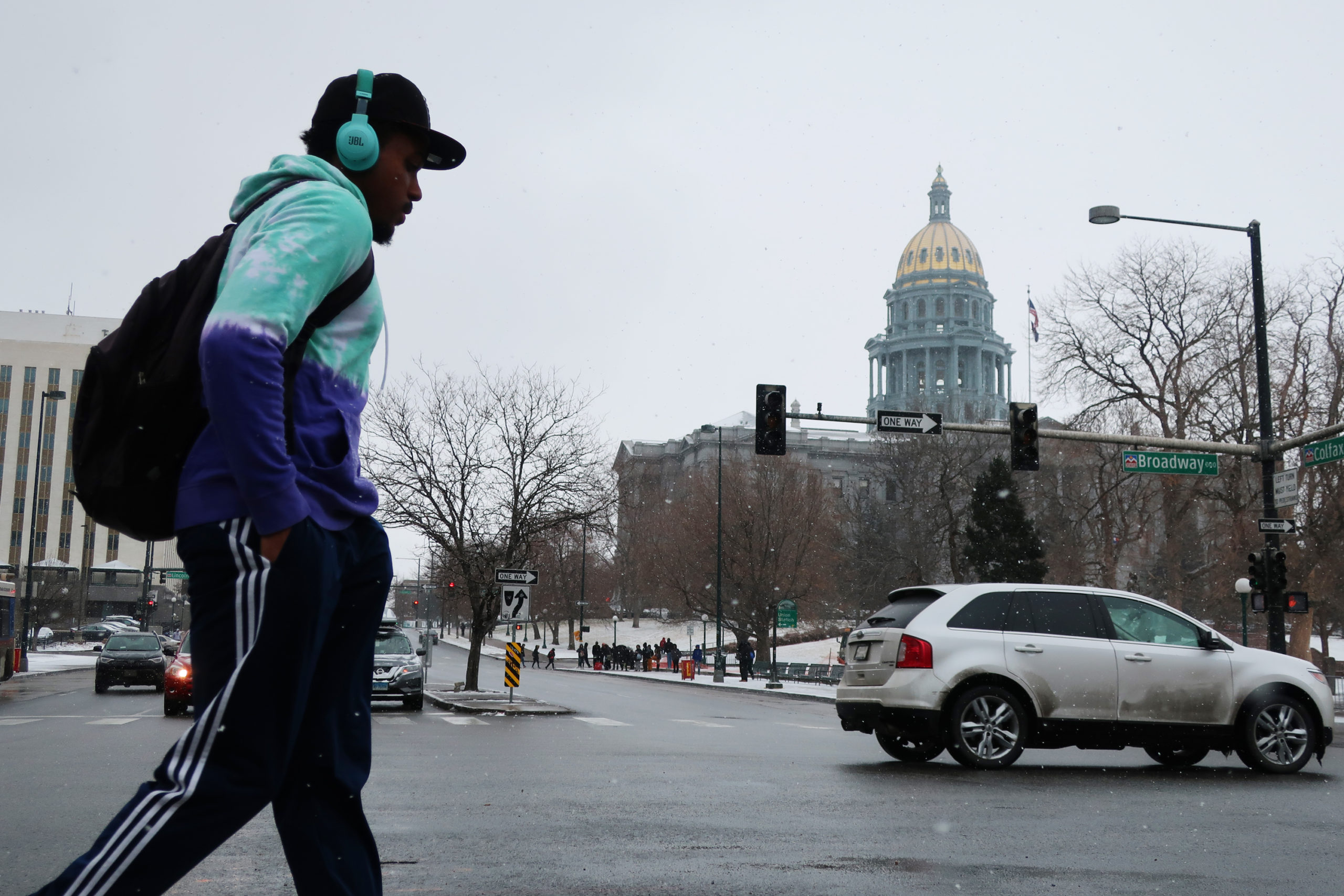 Denverites make their way through Monday's snowstorm by foot and by car on Feb. 3, 2020.
