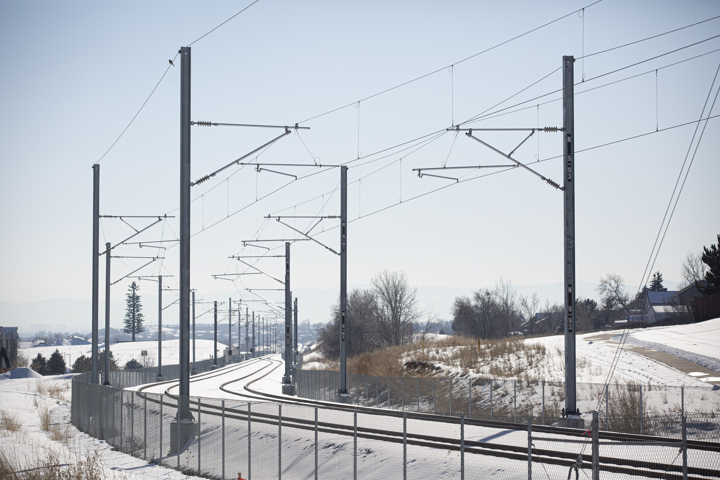 Tracks for RTD's N Line as seen from E 100th Avenue in Thornton, Colorado.