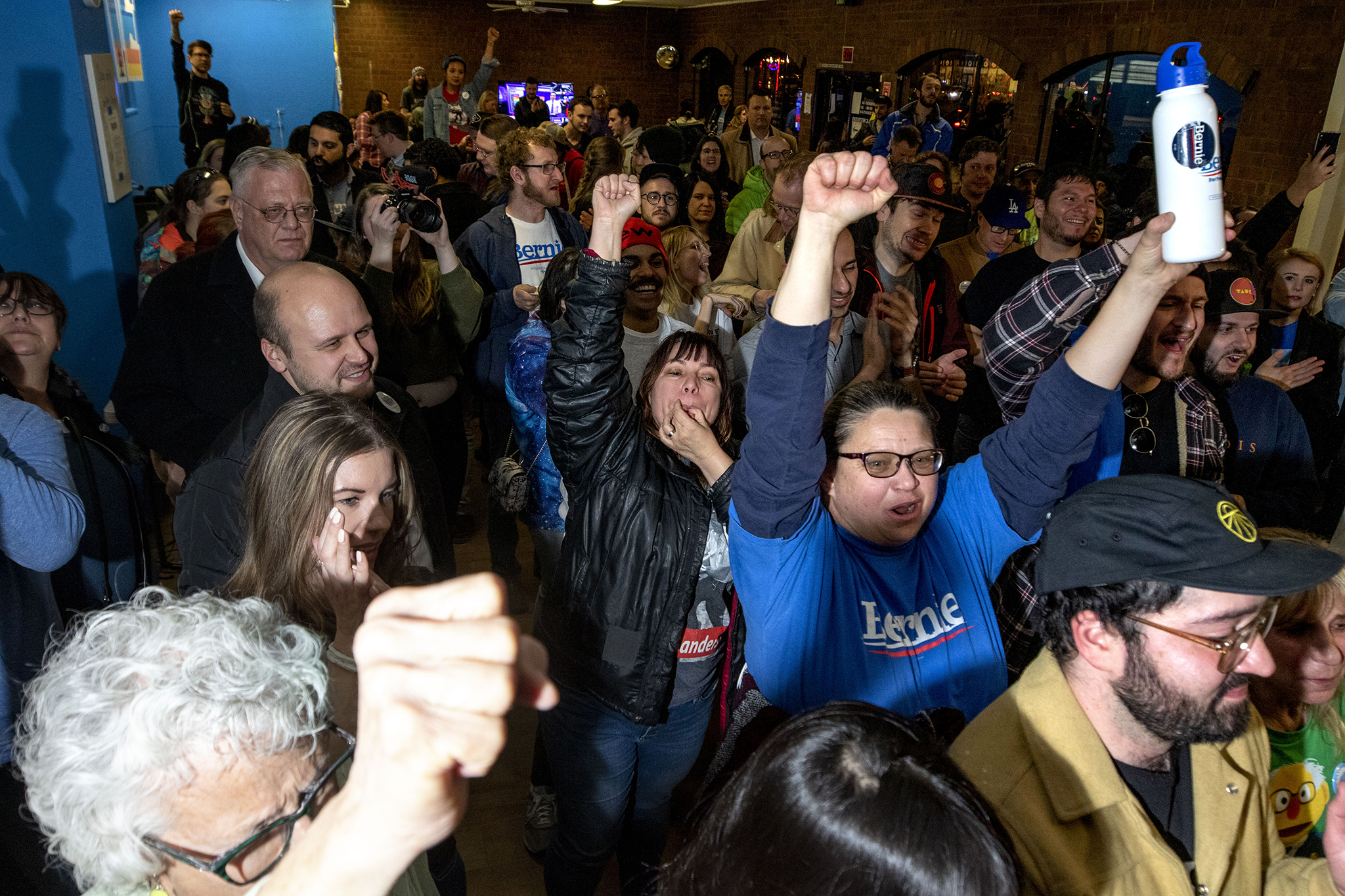 The Bernie Sanders campaign headquarters celebrates as the Vermont Senator is projected to win Colorado.