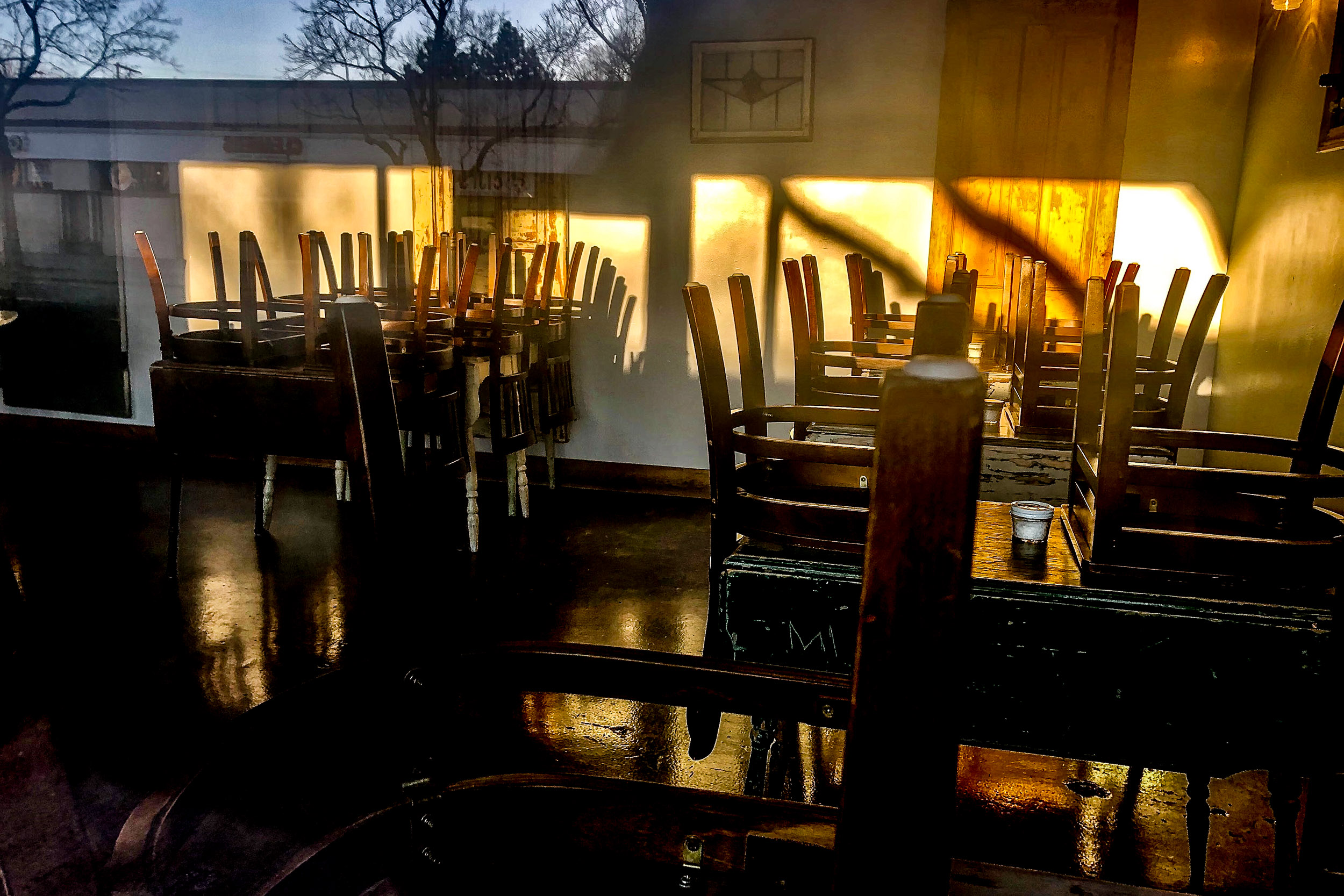 Empty Restaurant Chairs On Tables