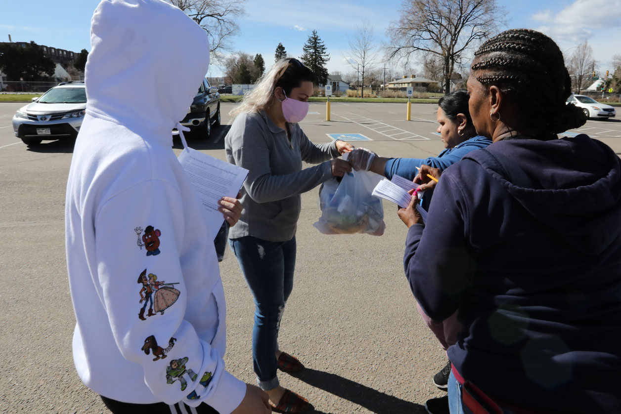 Aurora Public Schools nutrition workers distribute meals