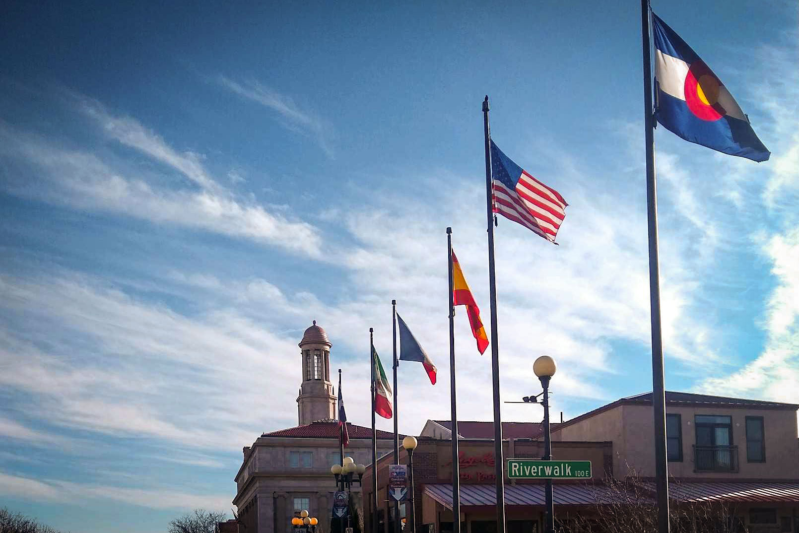 Some of the flags that fly along the Union Avenue Bridge that crosses over the Historic Arkansas Riverwalk in Pueblo, Colorado, March 16, 2020.