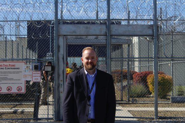 Idaho Department of Correction Director Josh Tewalt stands in front of the Idaho State Correctional Center.