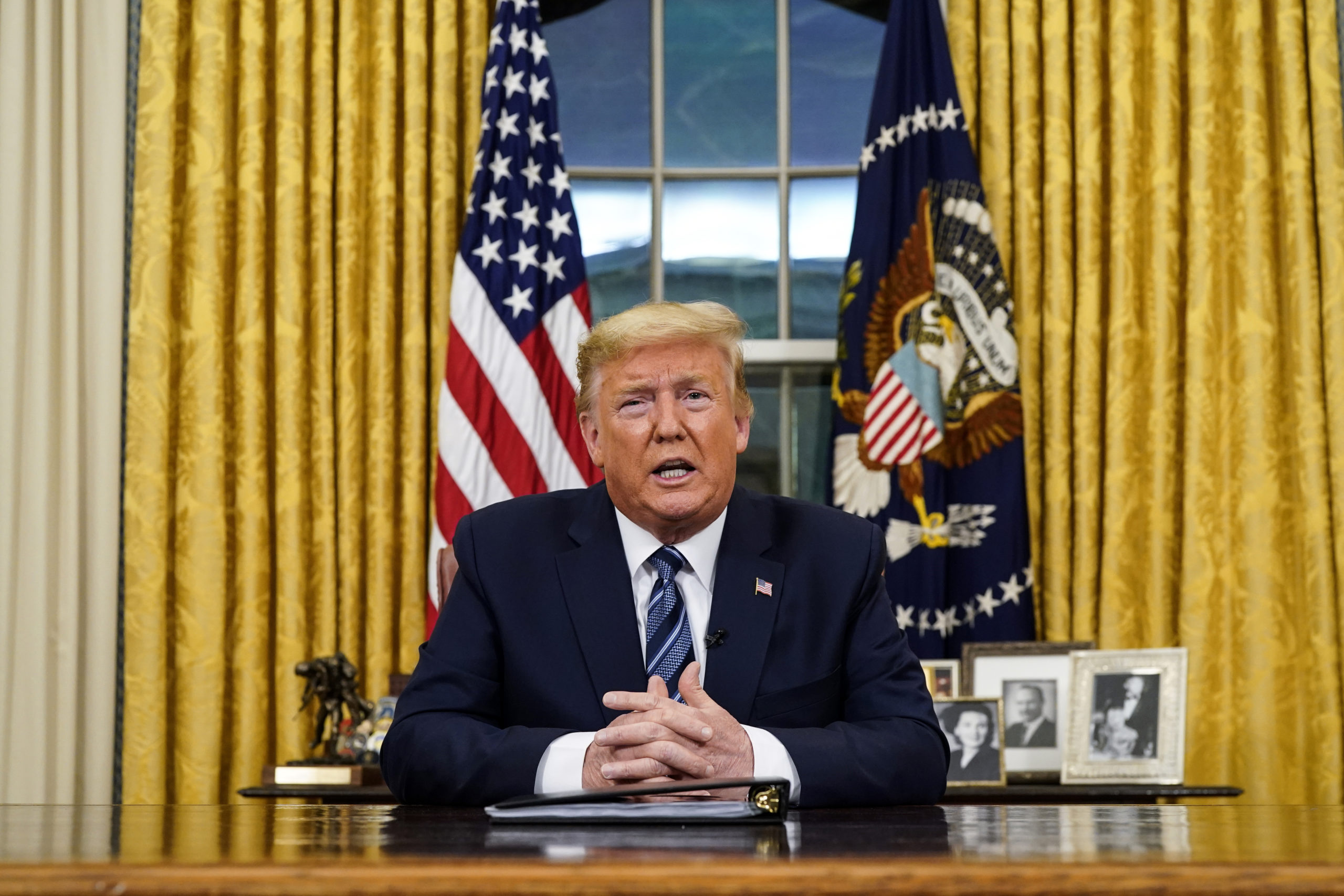 President Donald Trump speaks in an address to the nation from the Oval Office at the White House about the coronavirus Wednesday, March, 11, 2020, in Washington.