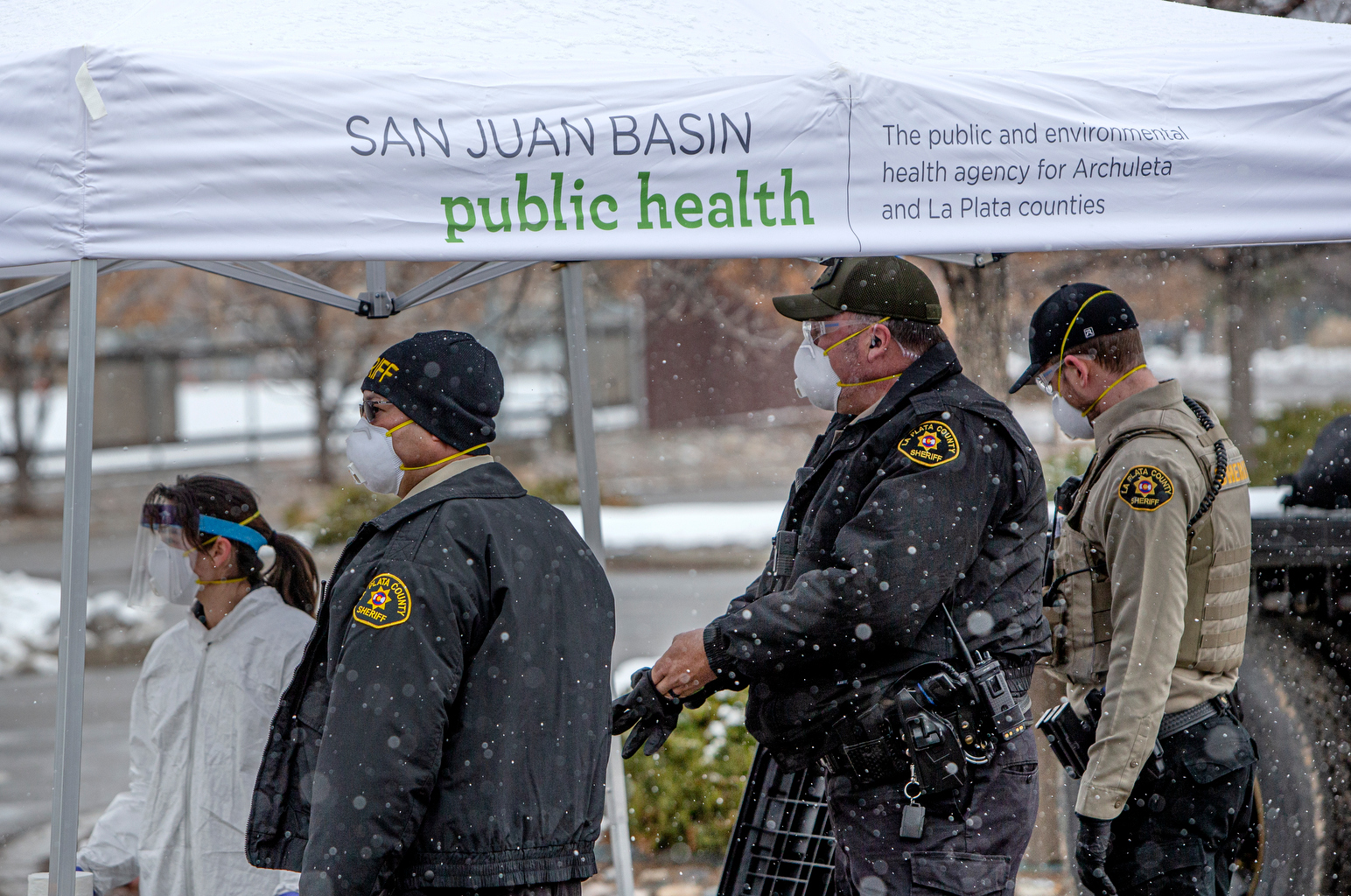 La Plata County sheriff deputies and medical personnel get ready to open a drive through coronavirus testing facility at the La Plata County fairgrounds on March 20, 2020. The facility, put on by San Juan Basin Public Health, will test 100 people for the virus.