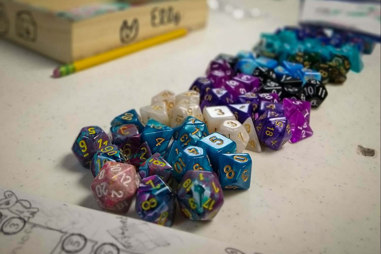 Mult-sided dice line the table at a Roll Play Lead game held in Castle Rock.