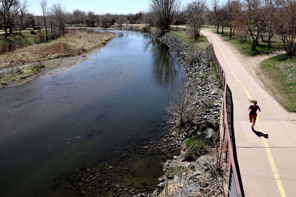 A runner beside the South Platte River in Littleton