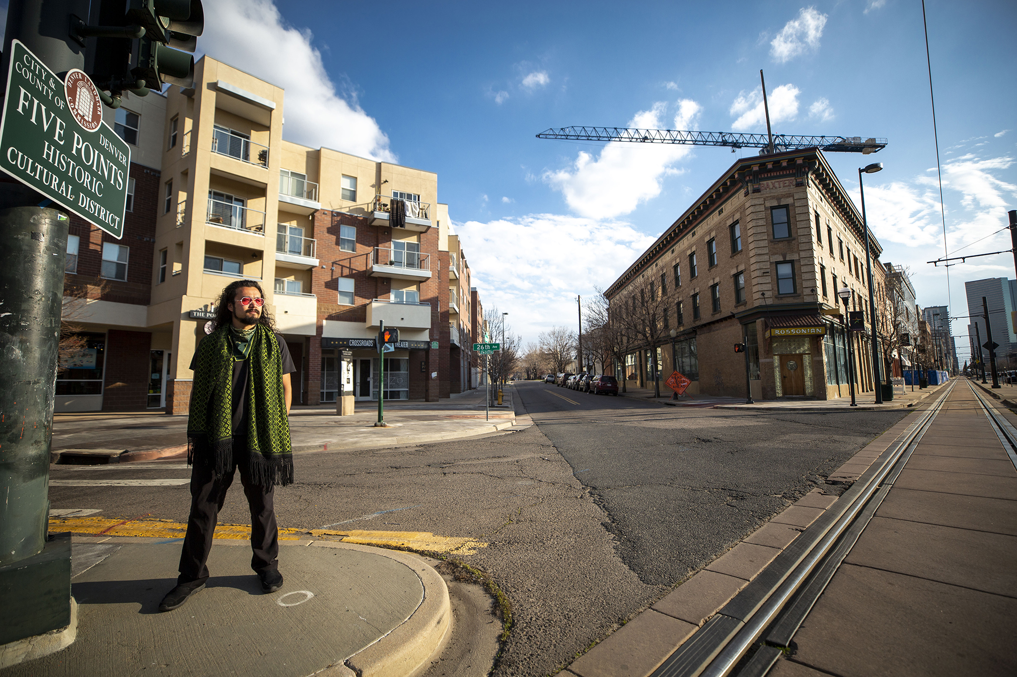 Ryan Foo poses in Five Points by the shuttered Crossroads Theater where the Black Actors Guild once held court. April 9, 2020.